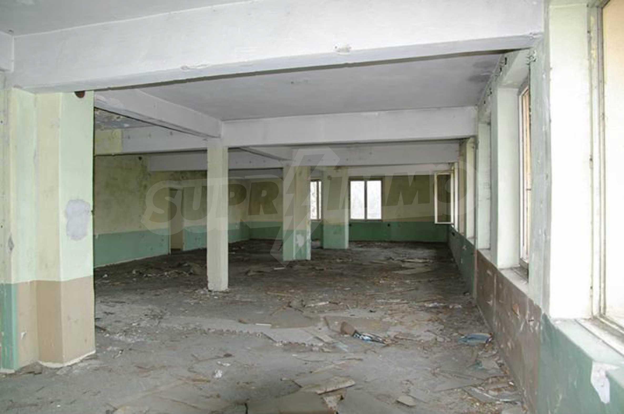 A massive three-storey warehouse  25
