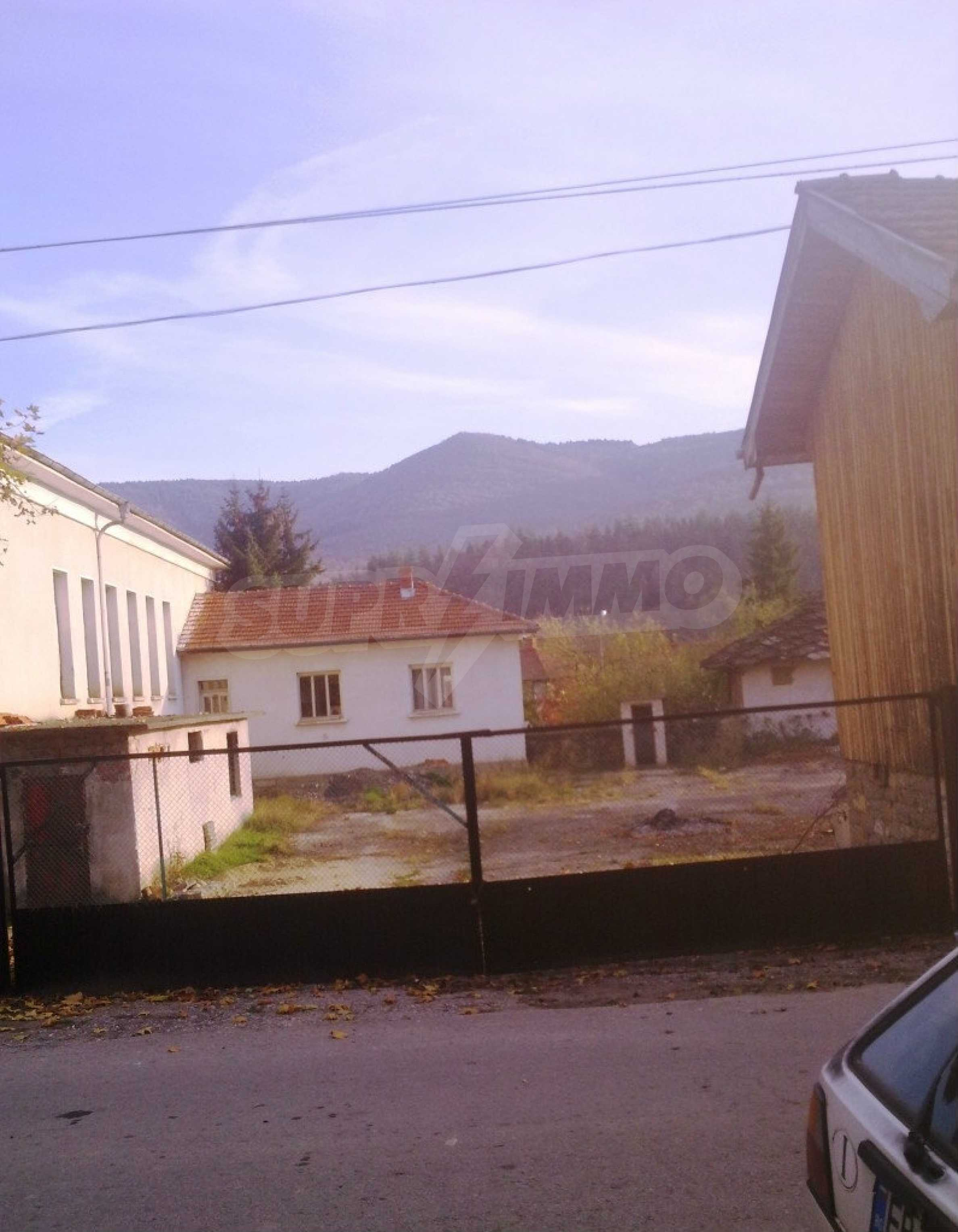Large brick-built house located in a village 22 km from the town of Apriltsi 12