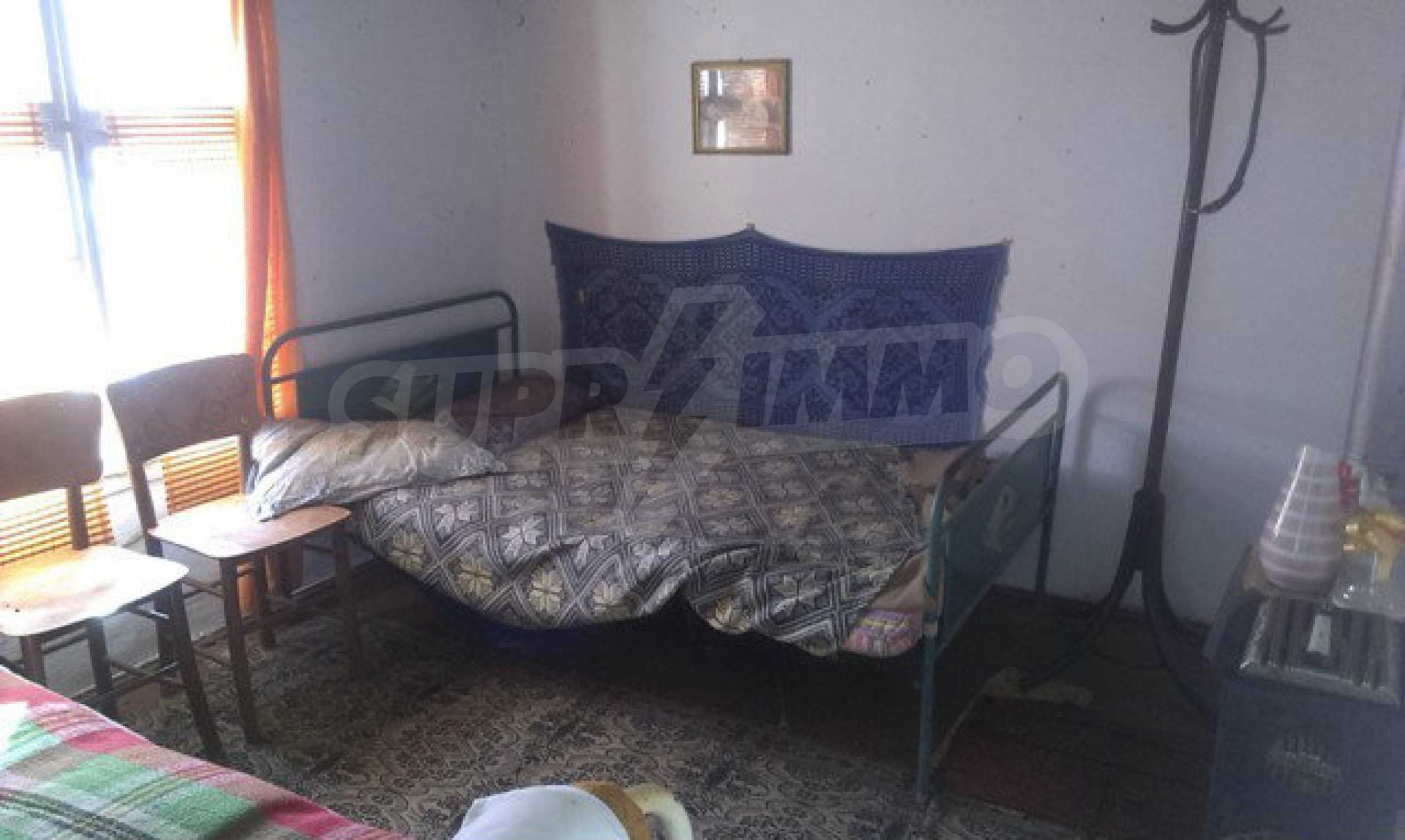 Two-storey village house with 1400 sq.m. yard 24