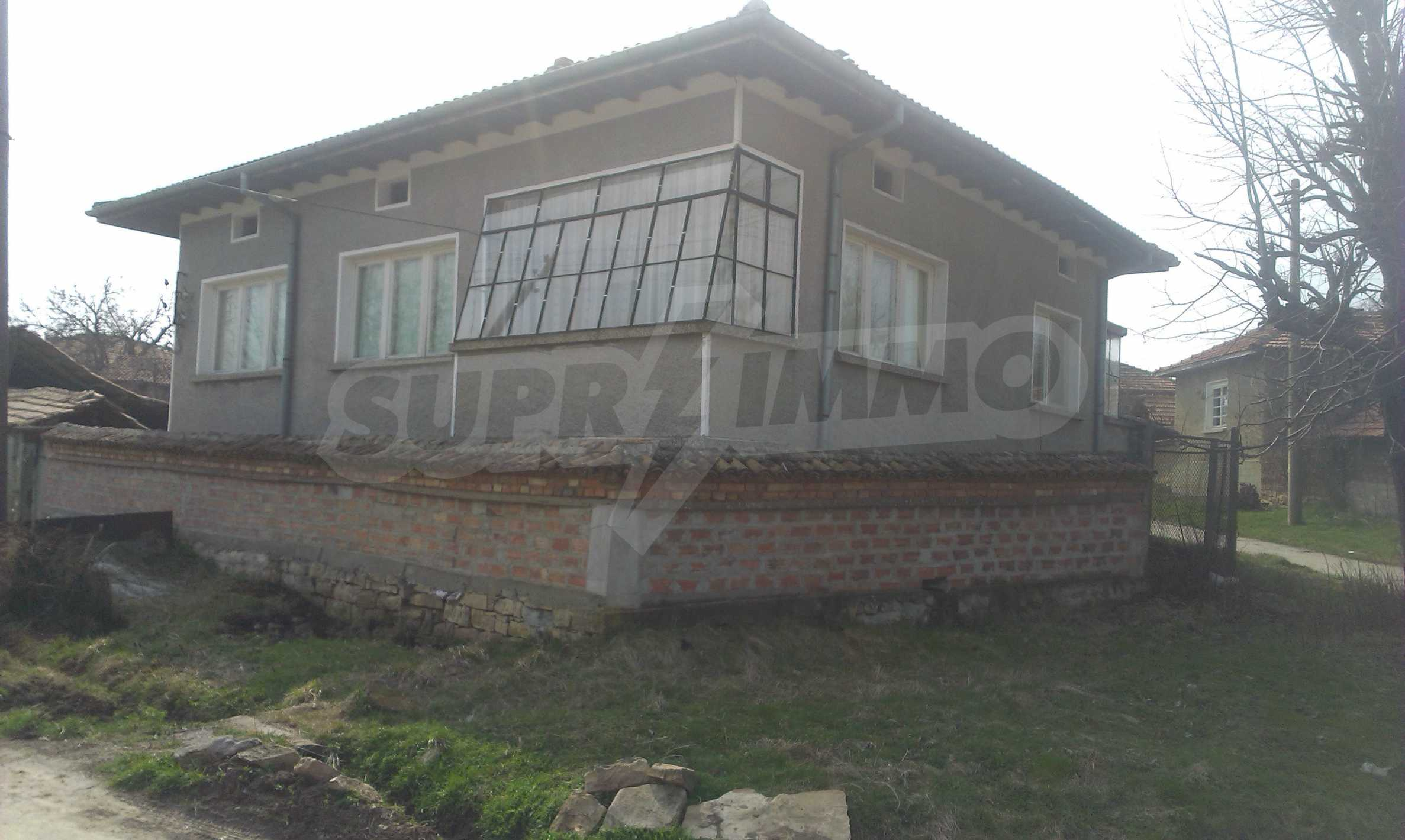 Spacious two-story brick house in a beautiful village 22