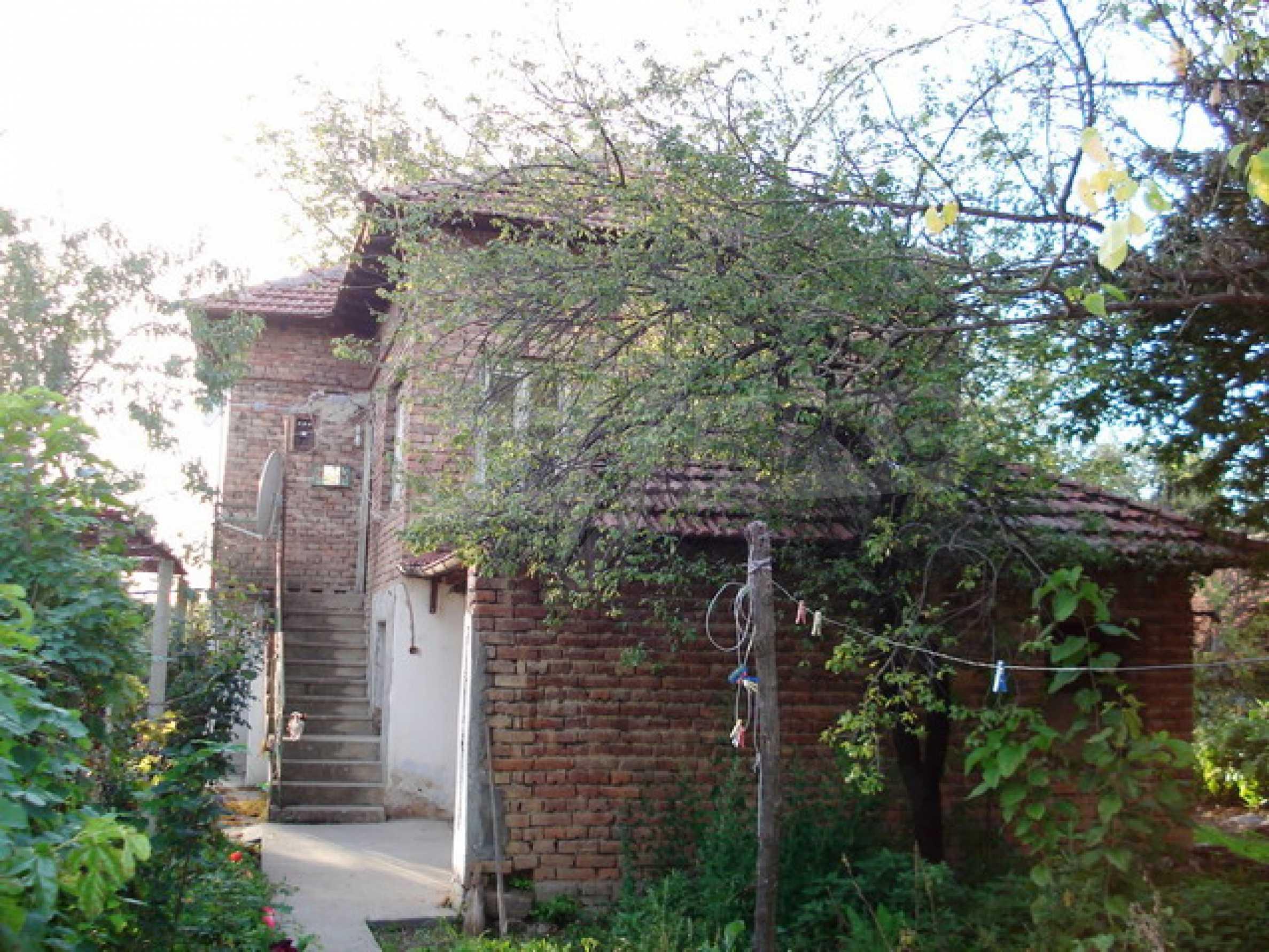 Кирпичный деревенский дом 5