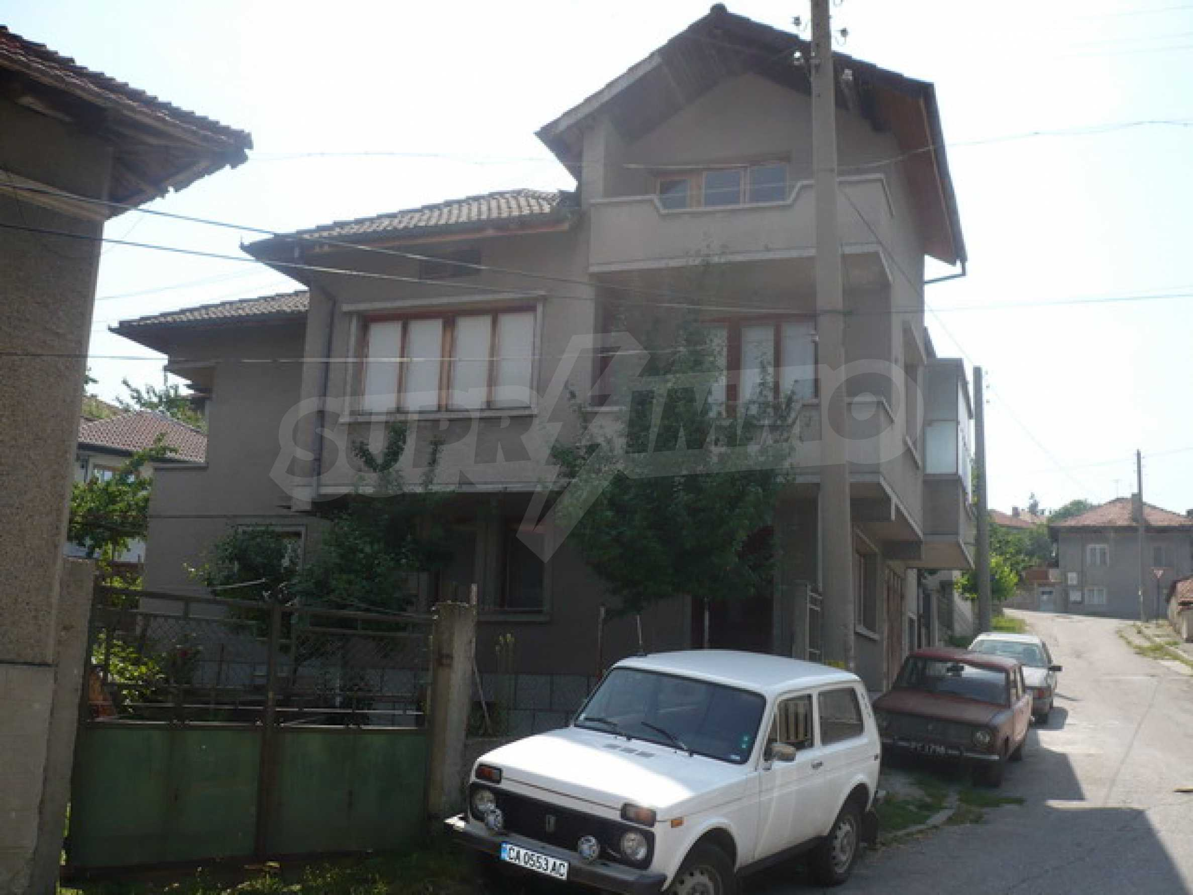 Spacious, three-storey massive house in a small town  1