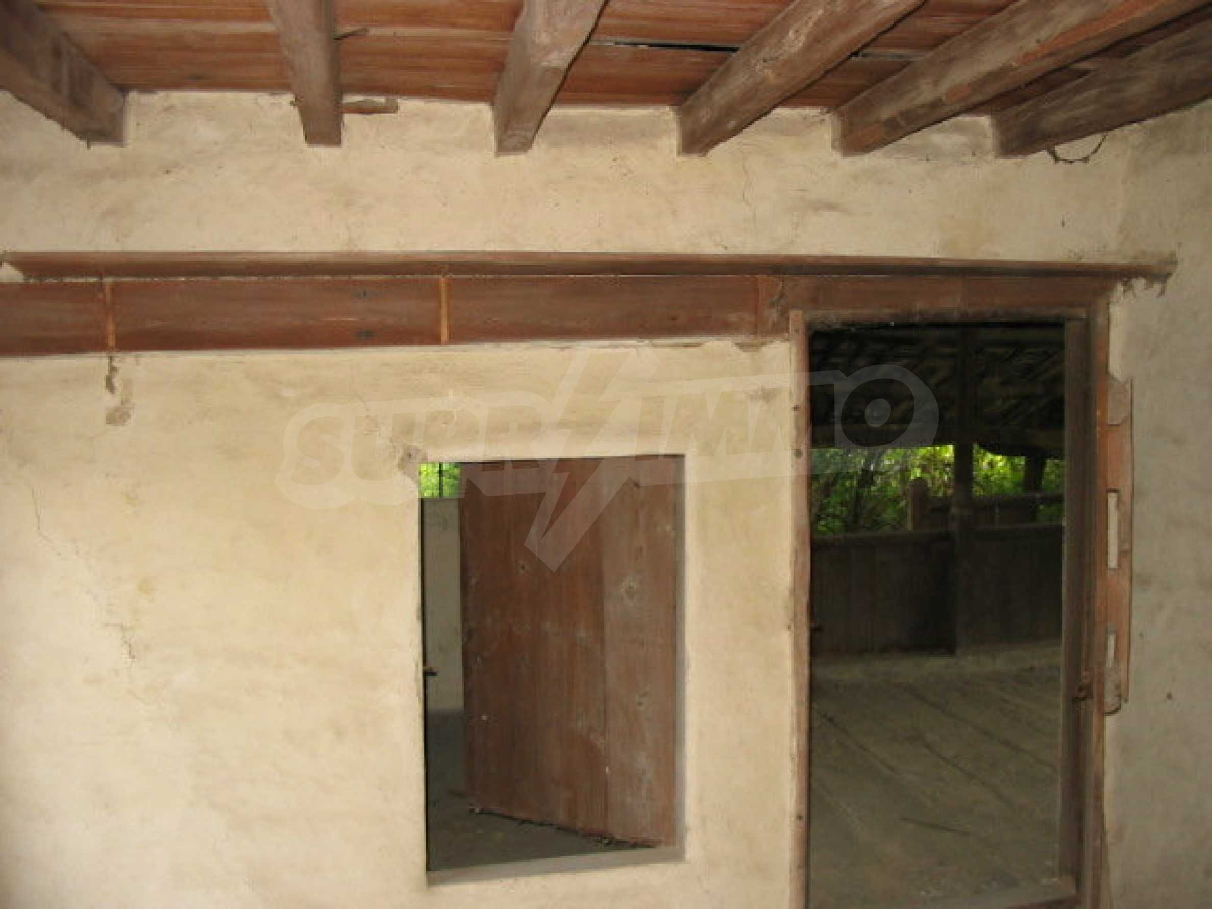 Two-storey traditional house for renovation in Mindya village  8