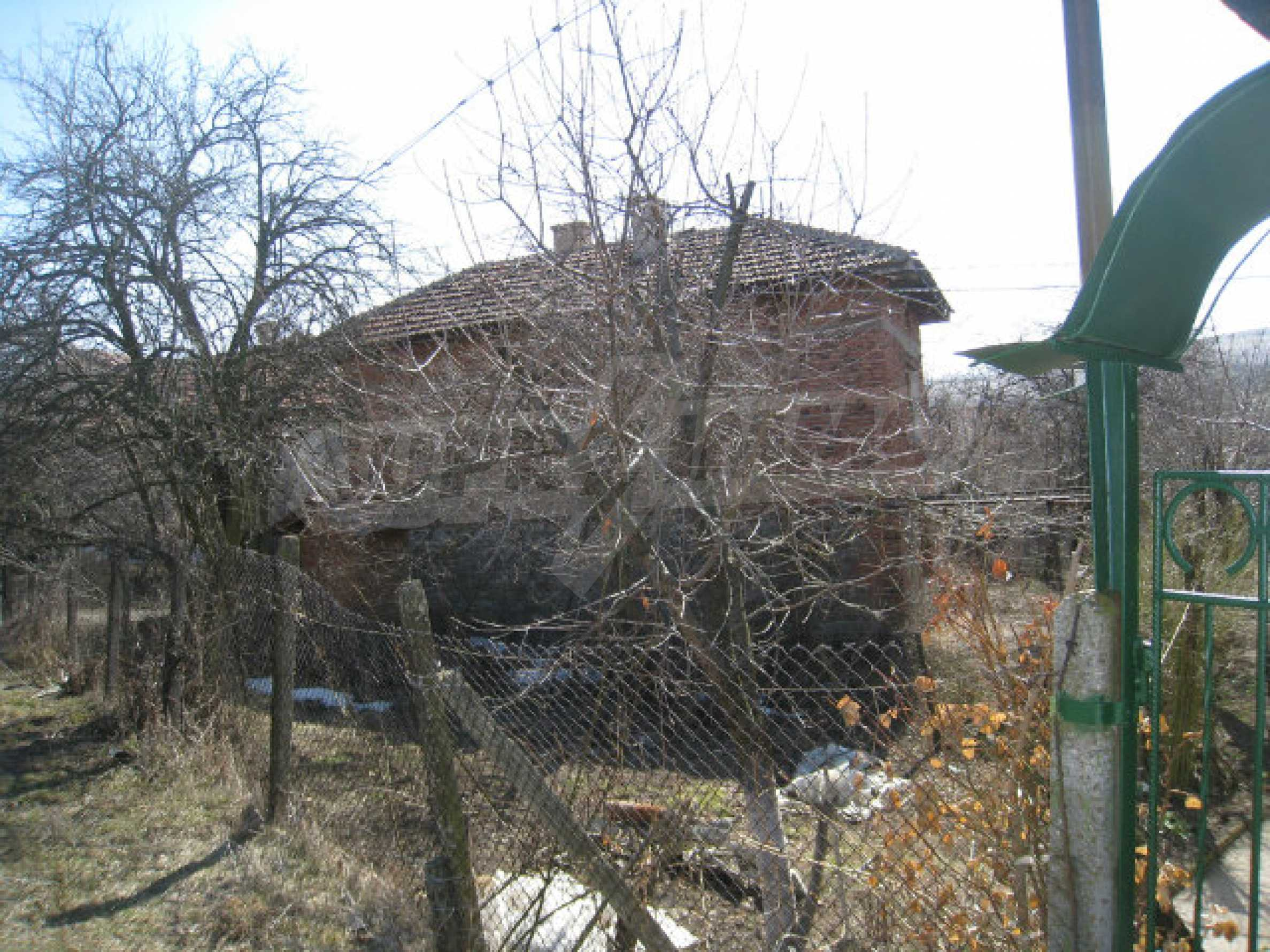 Old house with yard 70 km from Sofia 45