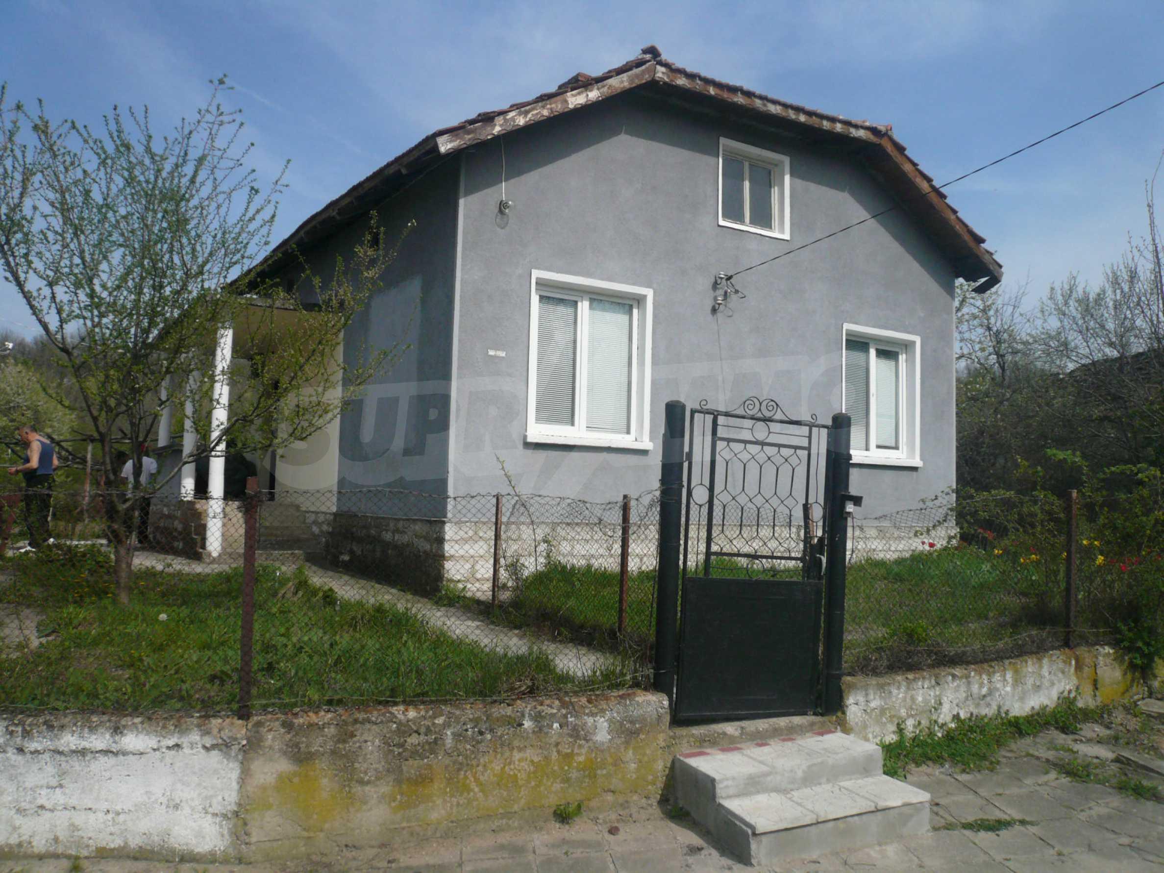 Einfamilienhaus mit Sommerküche und Garten