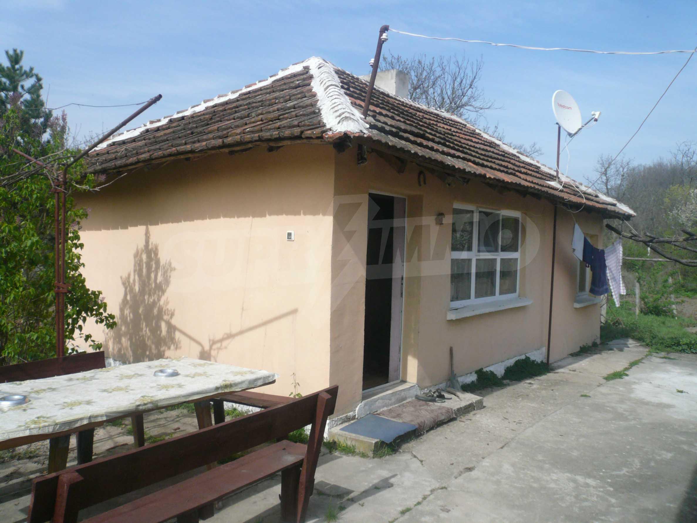Einfamilienhaus mit Sommerküche und Garten 10