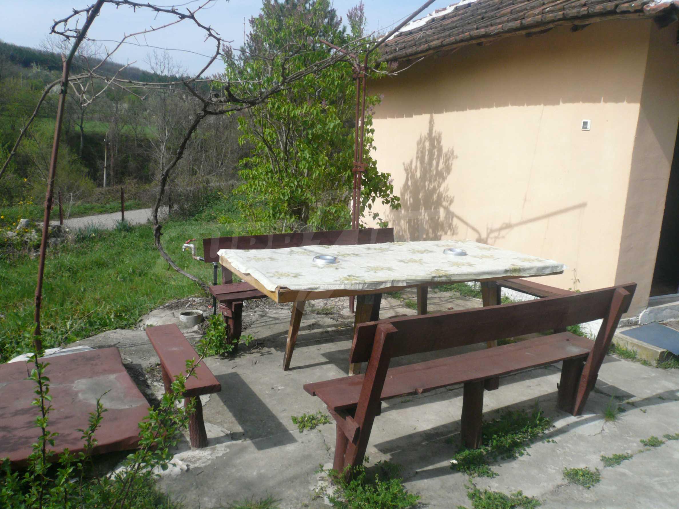 Einfamilienhaus mit Sommerküche und Garten 11