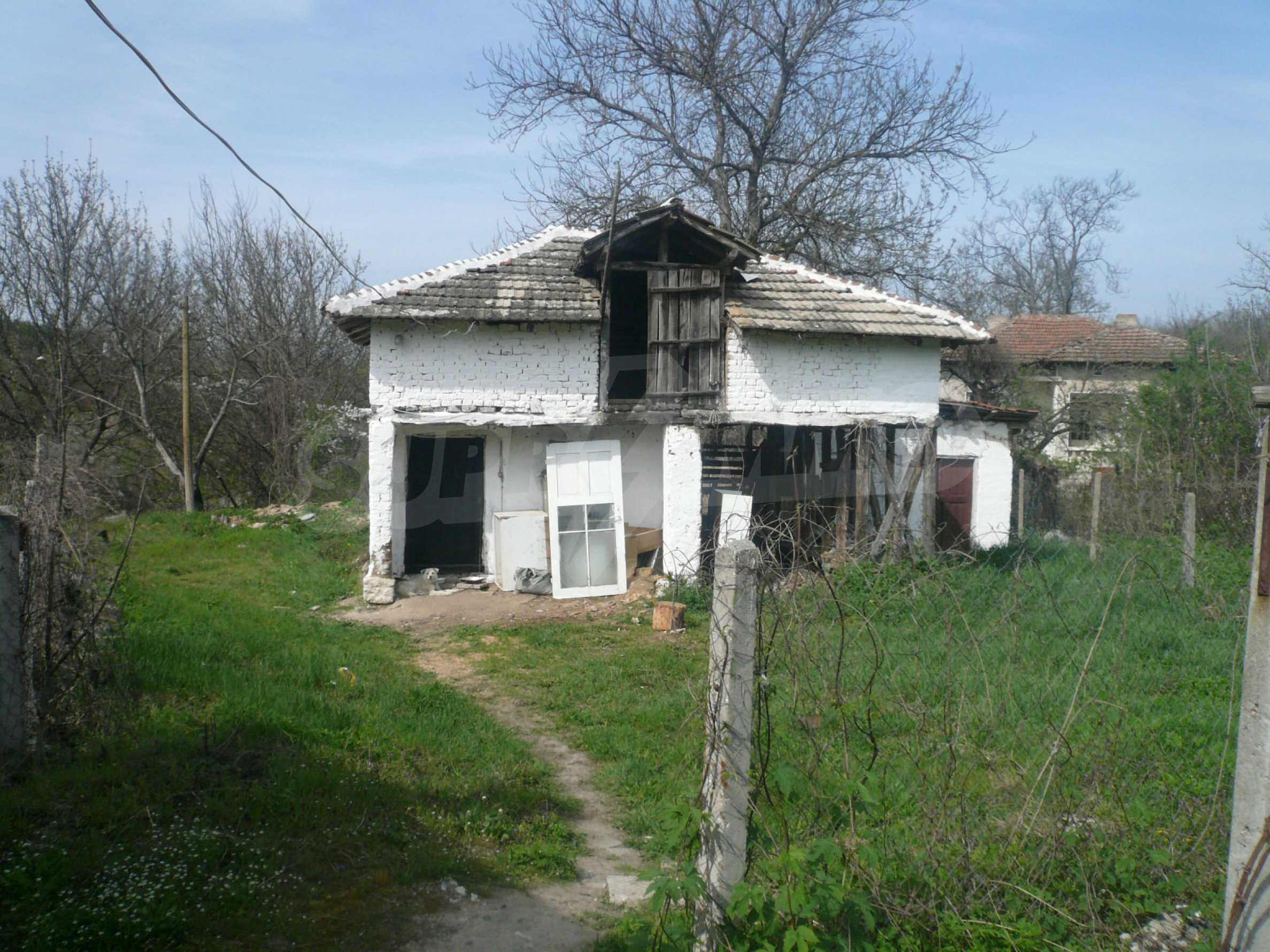 Einfamilienhaus mit Sommerküche und Garten 15