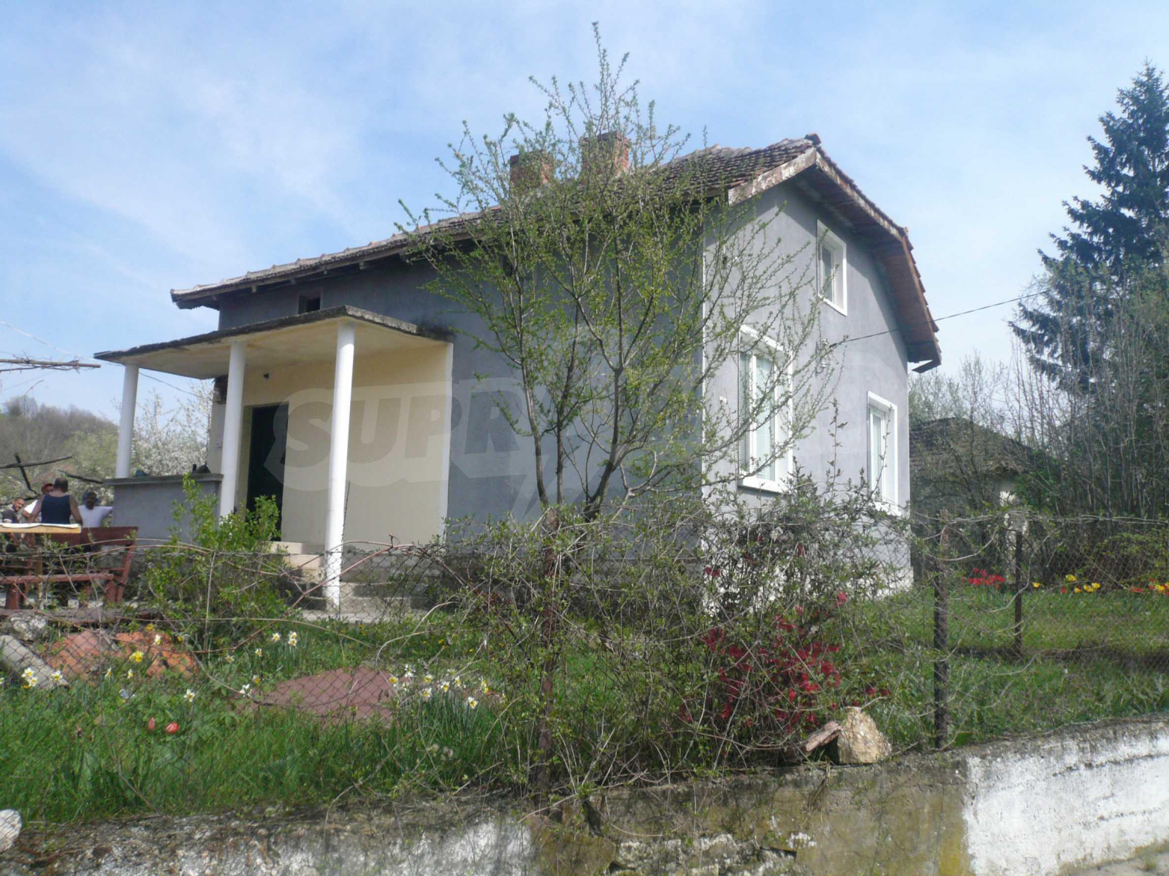 Einfamilienhaus mit Sommerküche und Garten 1