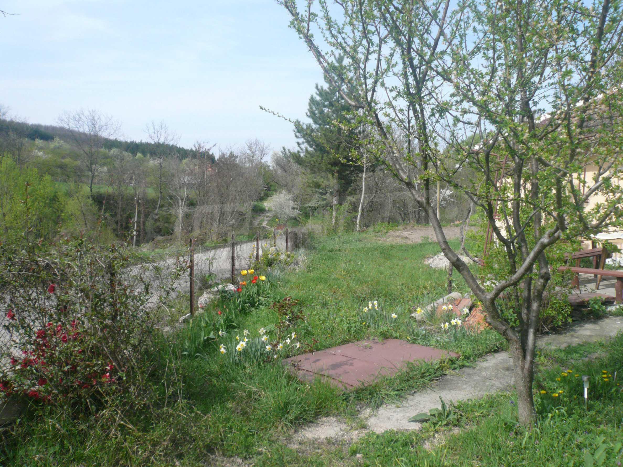 Einfamilienhaus mit Sommerküche und Garten 3