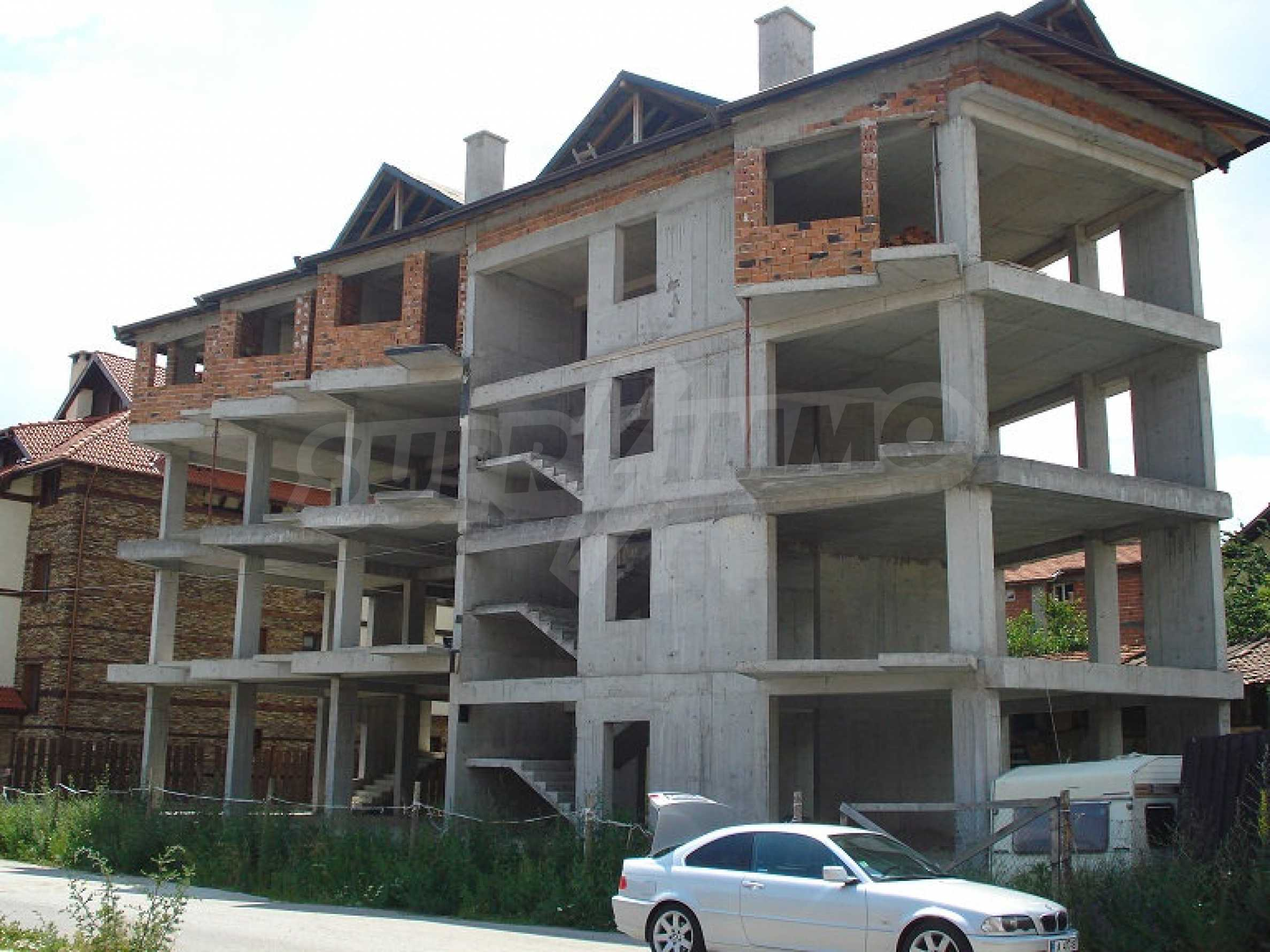 Three-storey hotel at shell stage for sale in Bansko  10