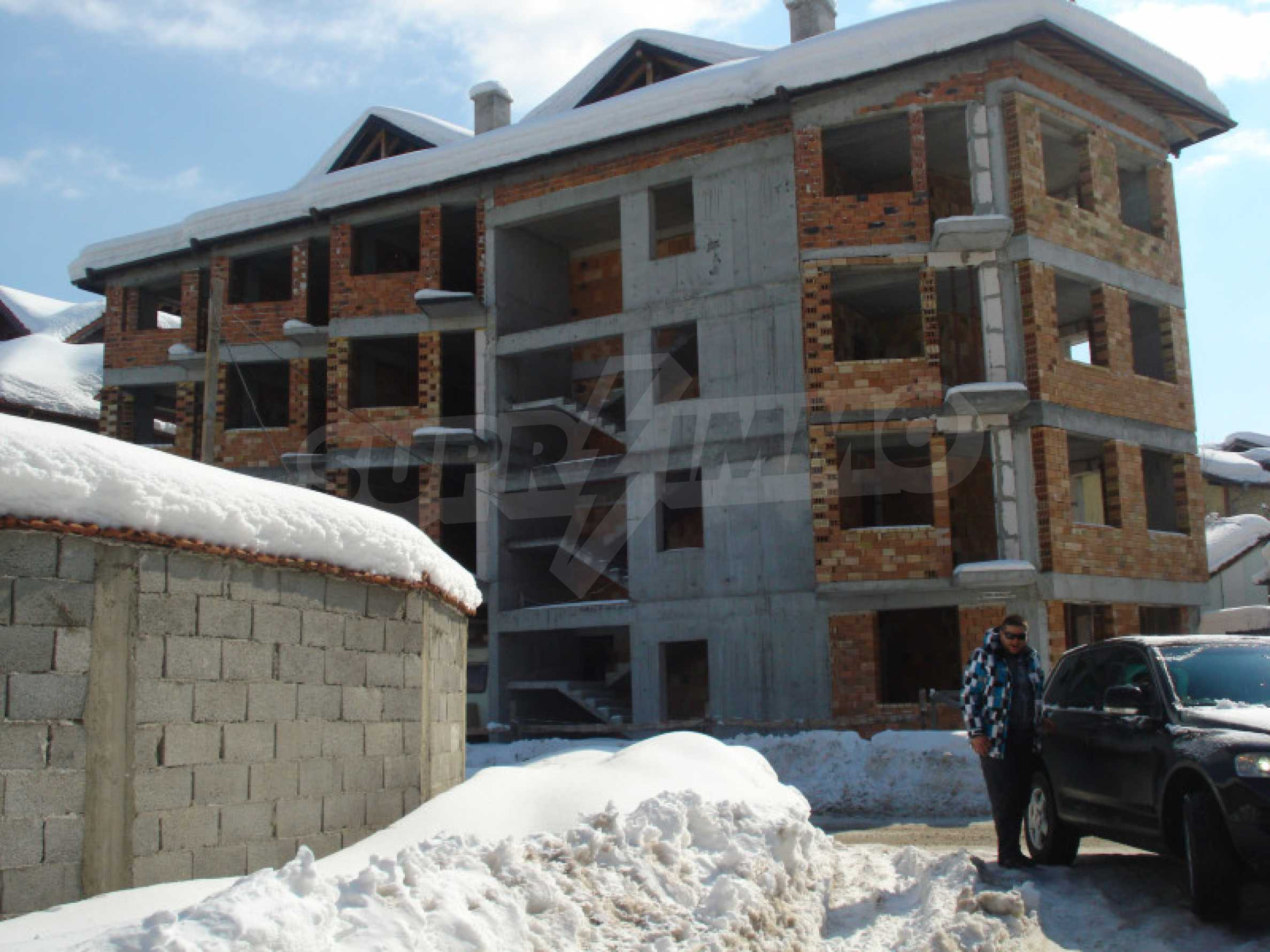 Three-storey hotel at shell stage for sale in Bansko  19