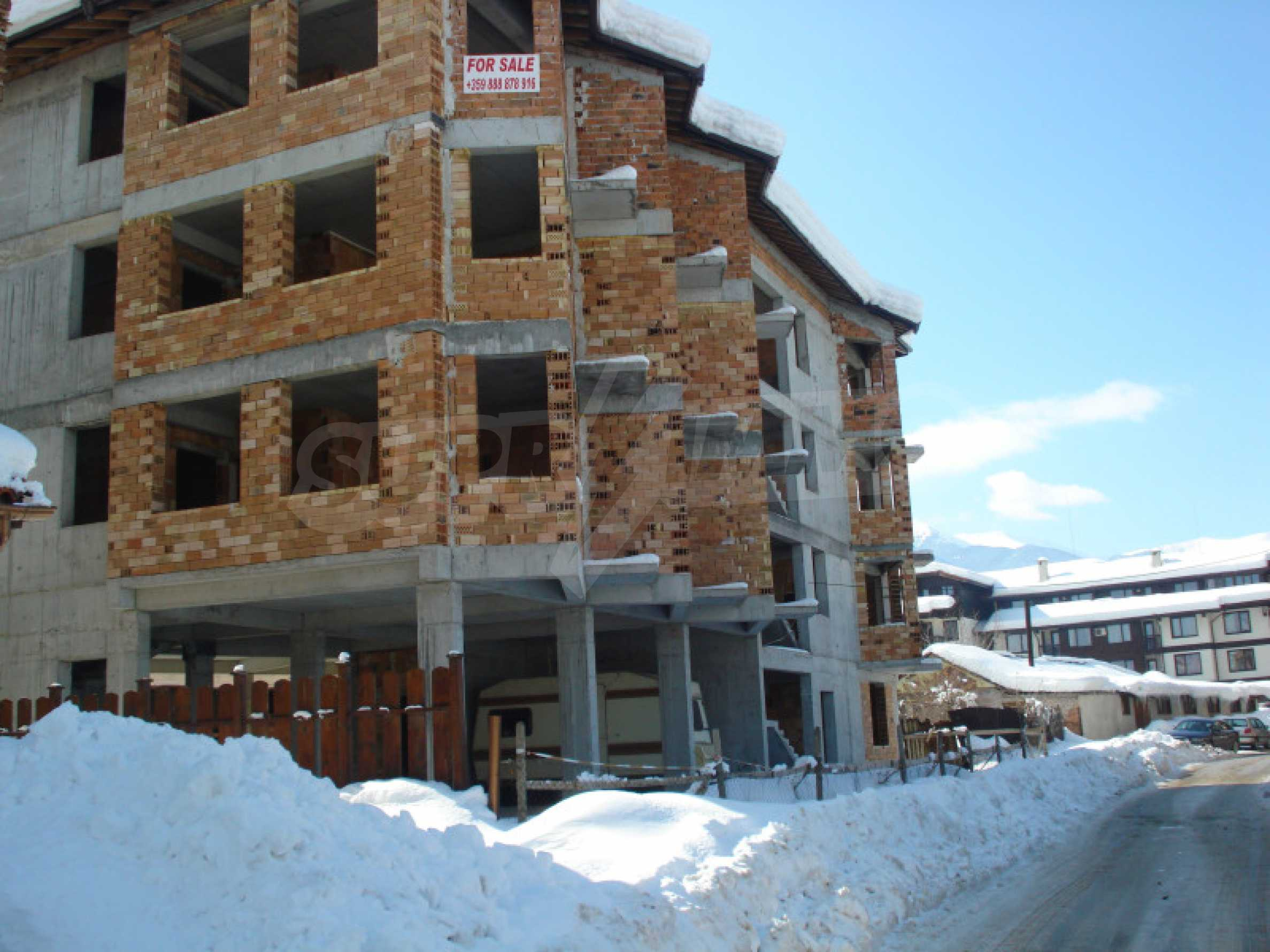 Three-storey hotel at shell stage for sale in Bansko  20
