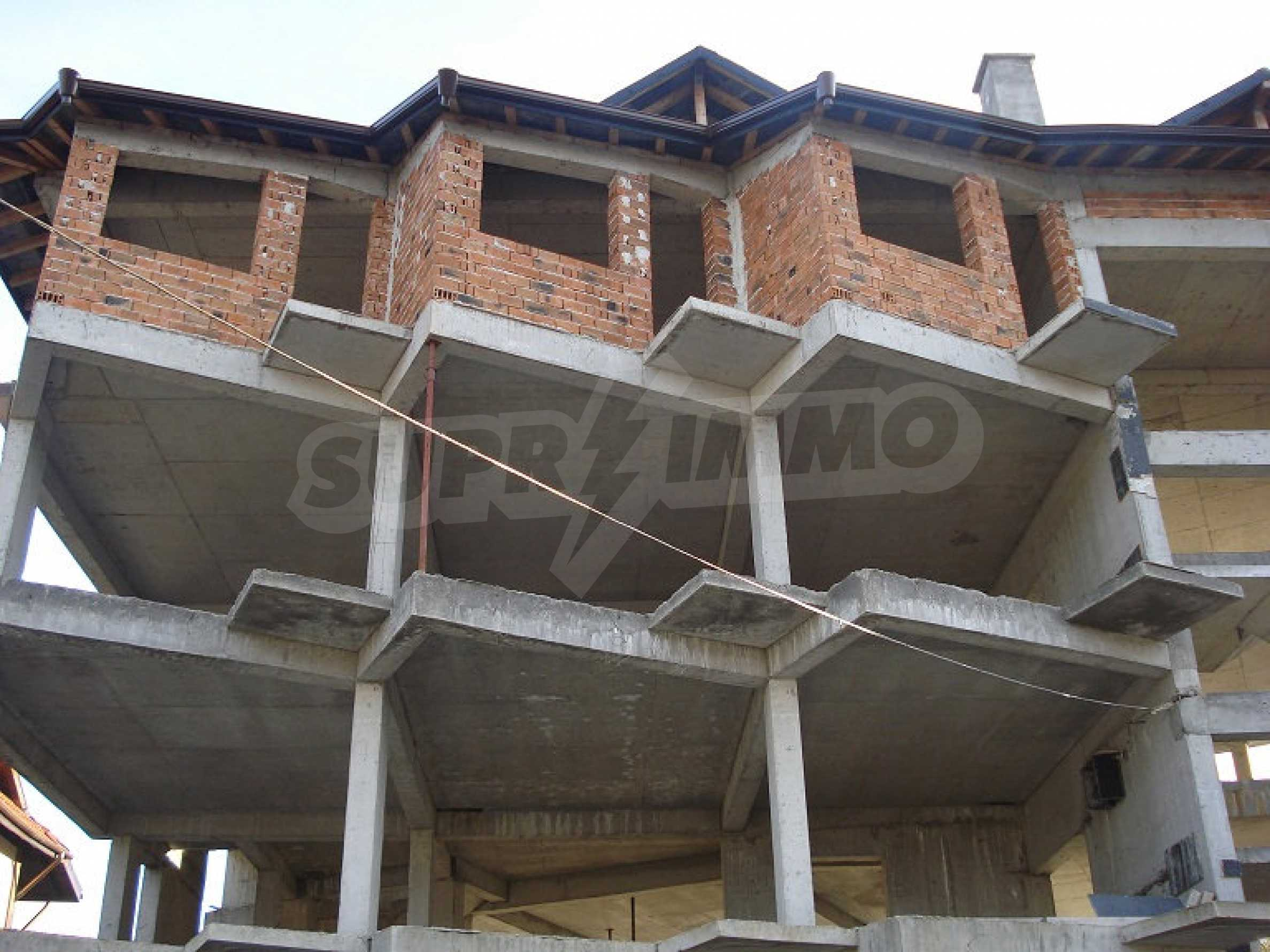 Three-storey hotel at shell stage for sale in Bansko  4