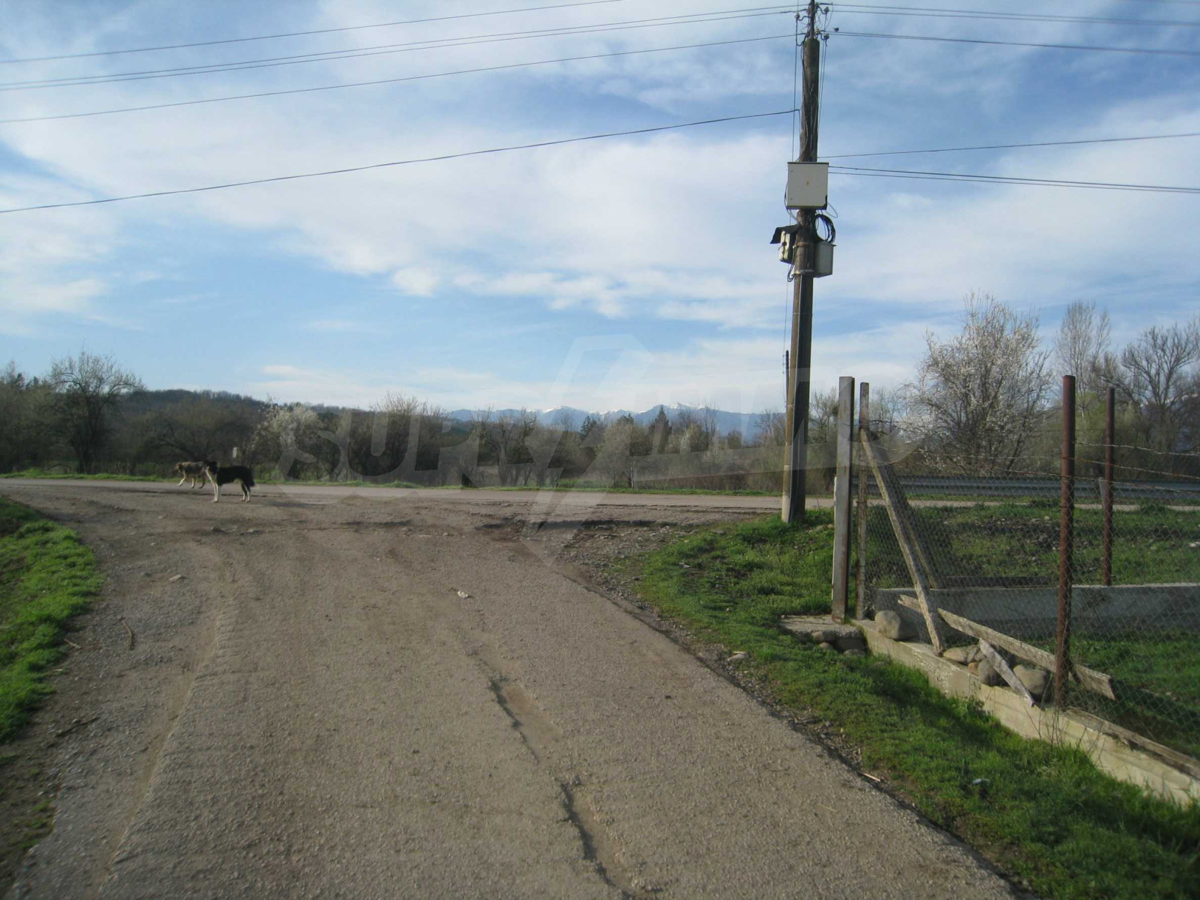 Fishpond, warehouses, residential areas and asphalt ground near Montana 49