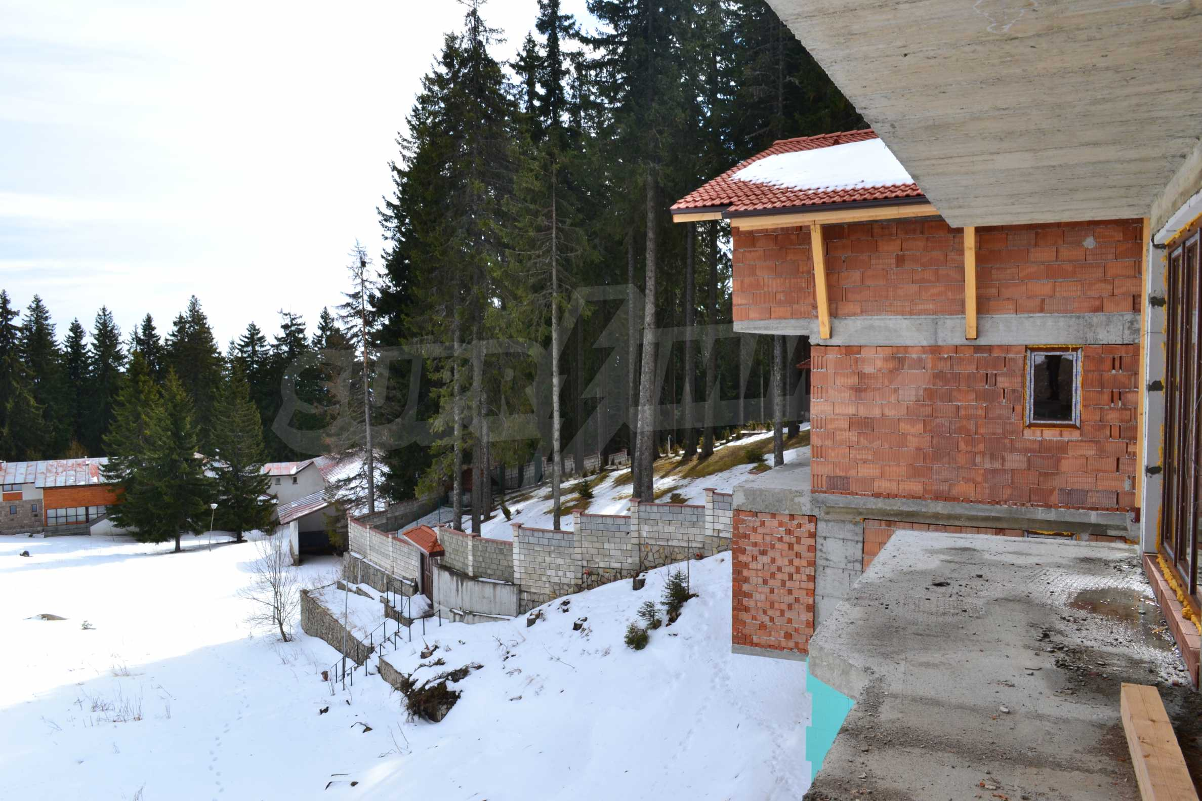 Modern, finished houses near the ski run and road in Pamporovo 14