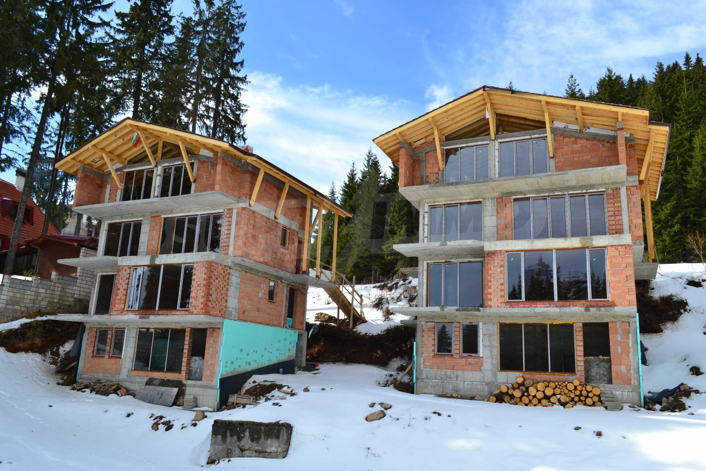 Modern, finished houses near the ski run and road in Pamporovo