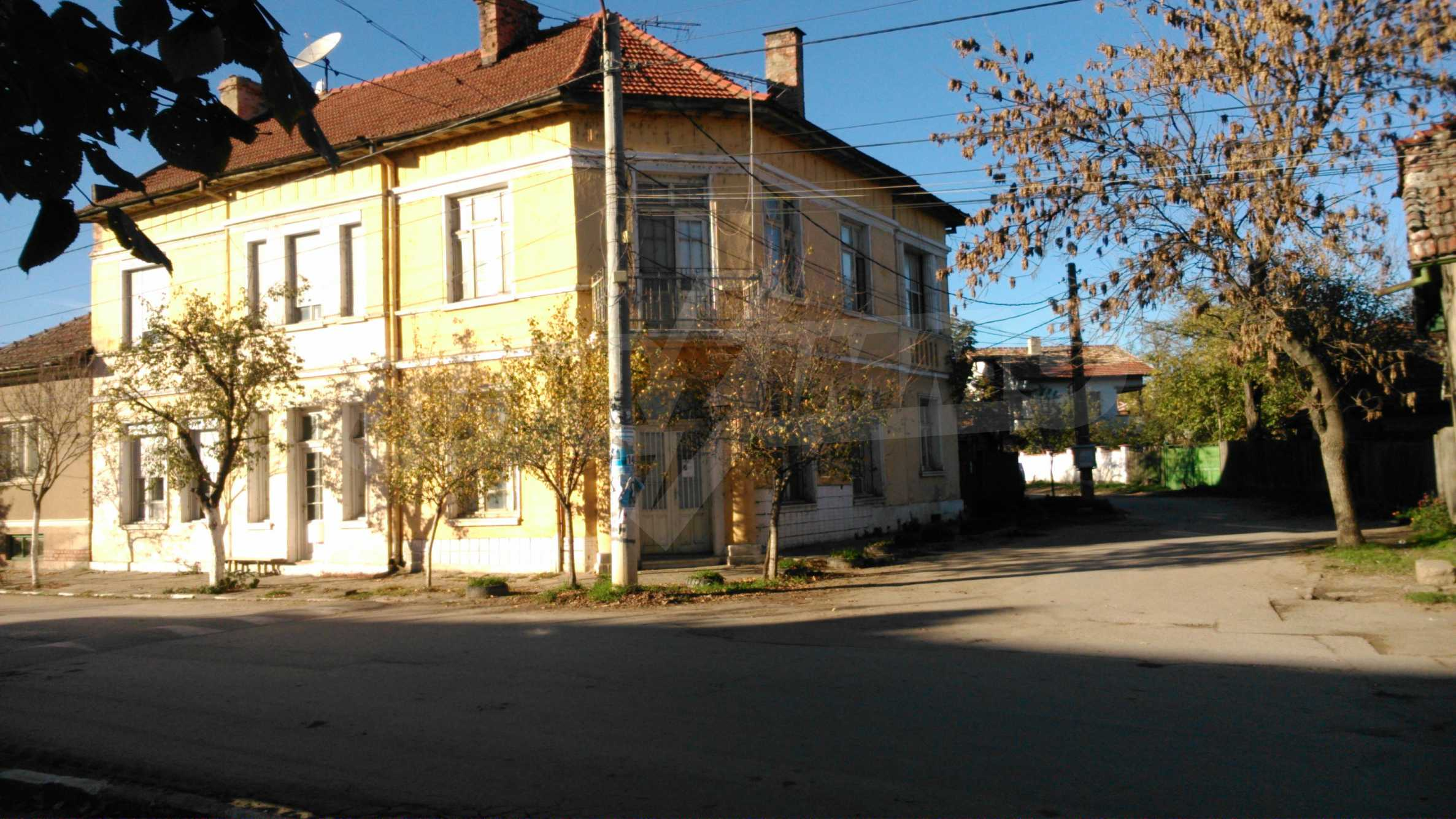 Two-storey house with yard in the center of developed village