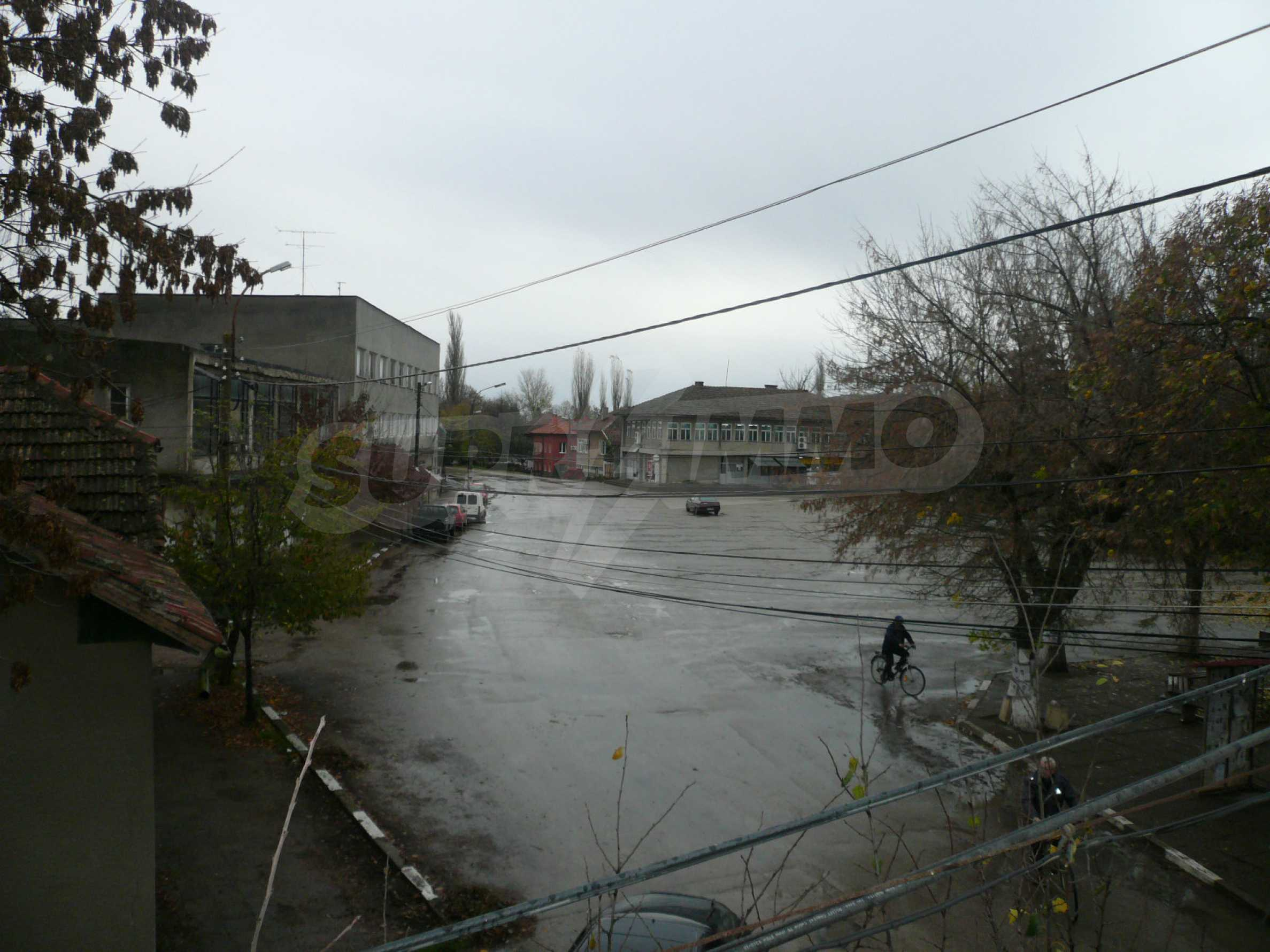 Two-storey house with yard in the center of developed village 15