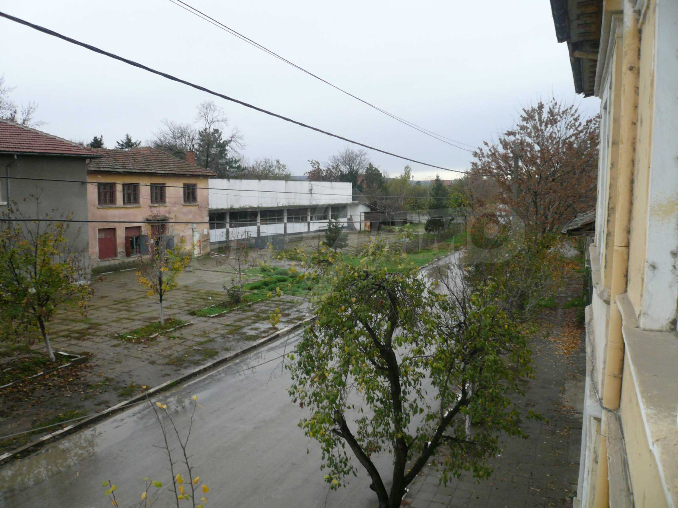 Two-storey house with yard in the center of developed village 16