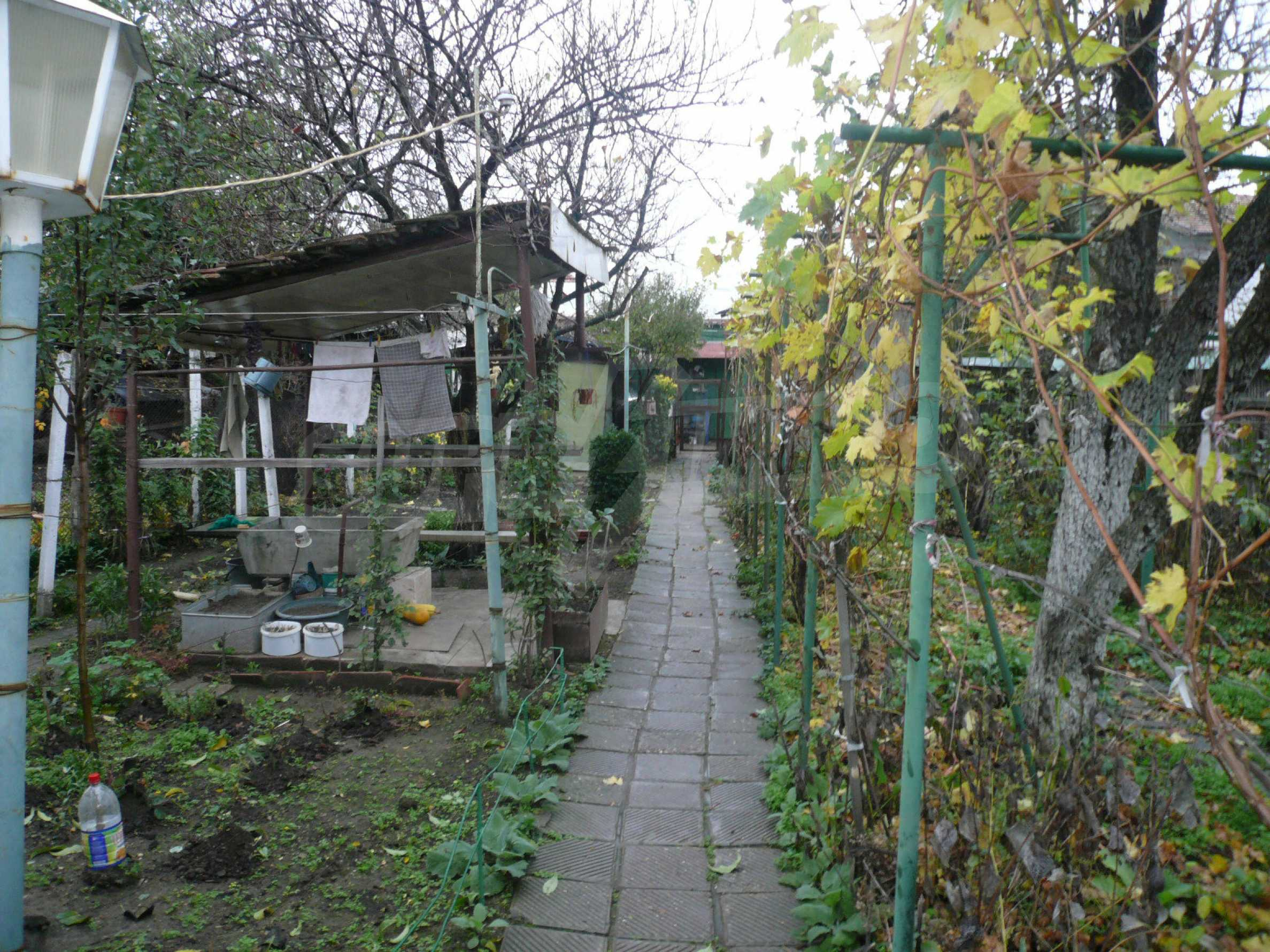 Two-storey house with yard in the center of developed village 17