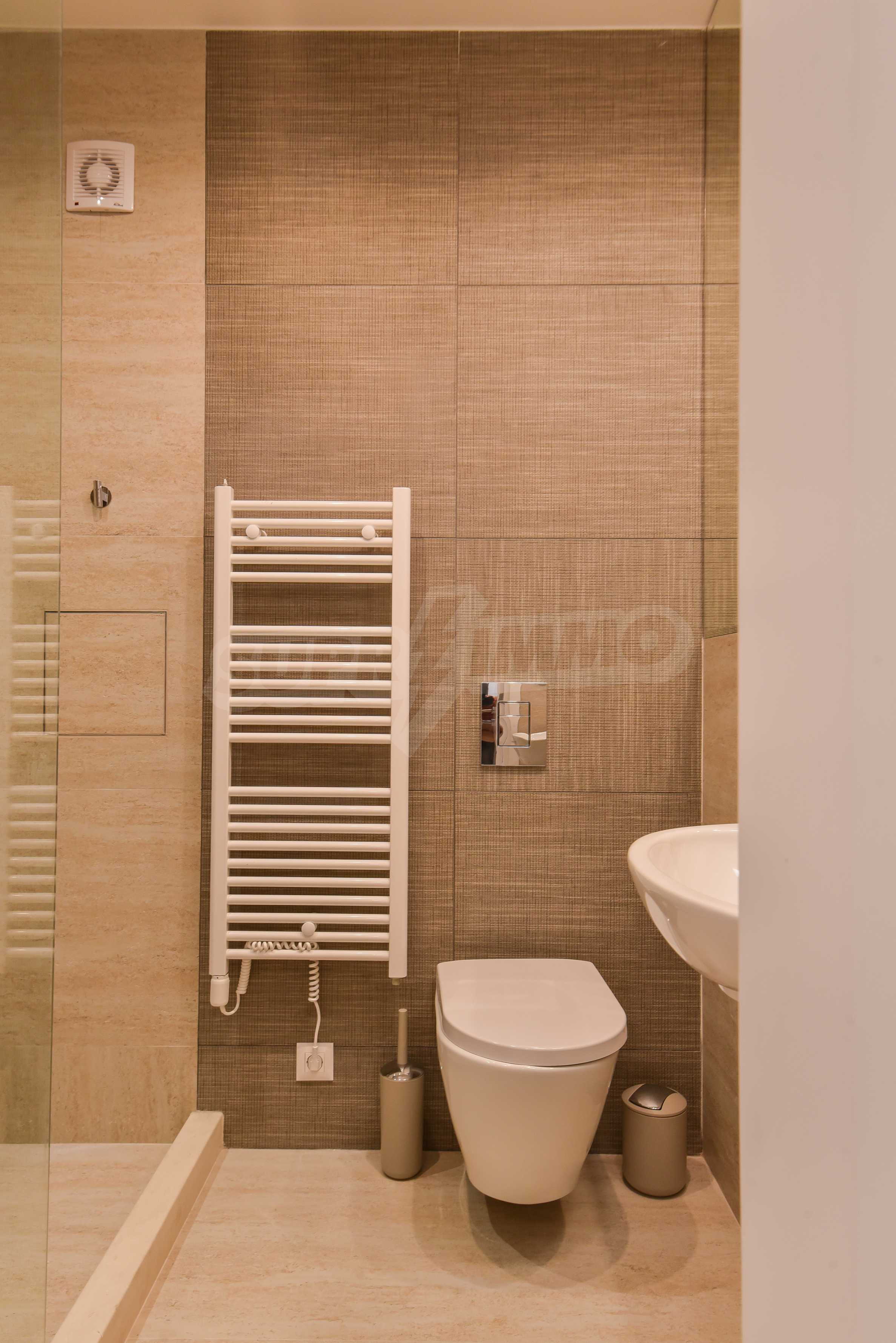 Modern three bedroom apartment with working business in the center of Sofia 14