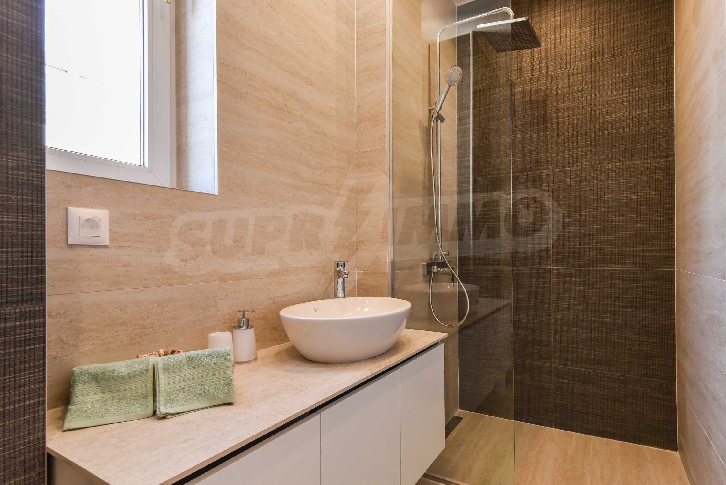 Modern three bedroom apartment with working business in the center of Sofia 22