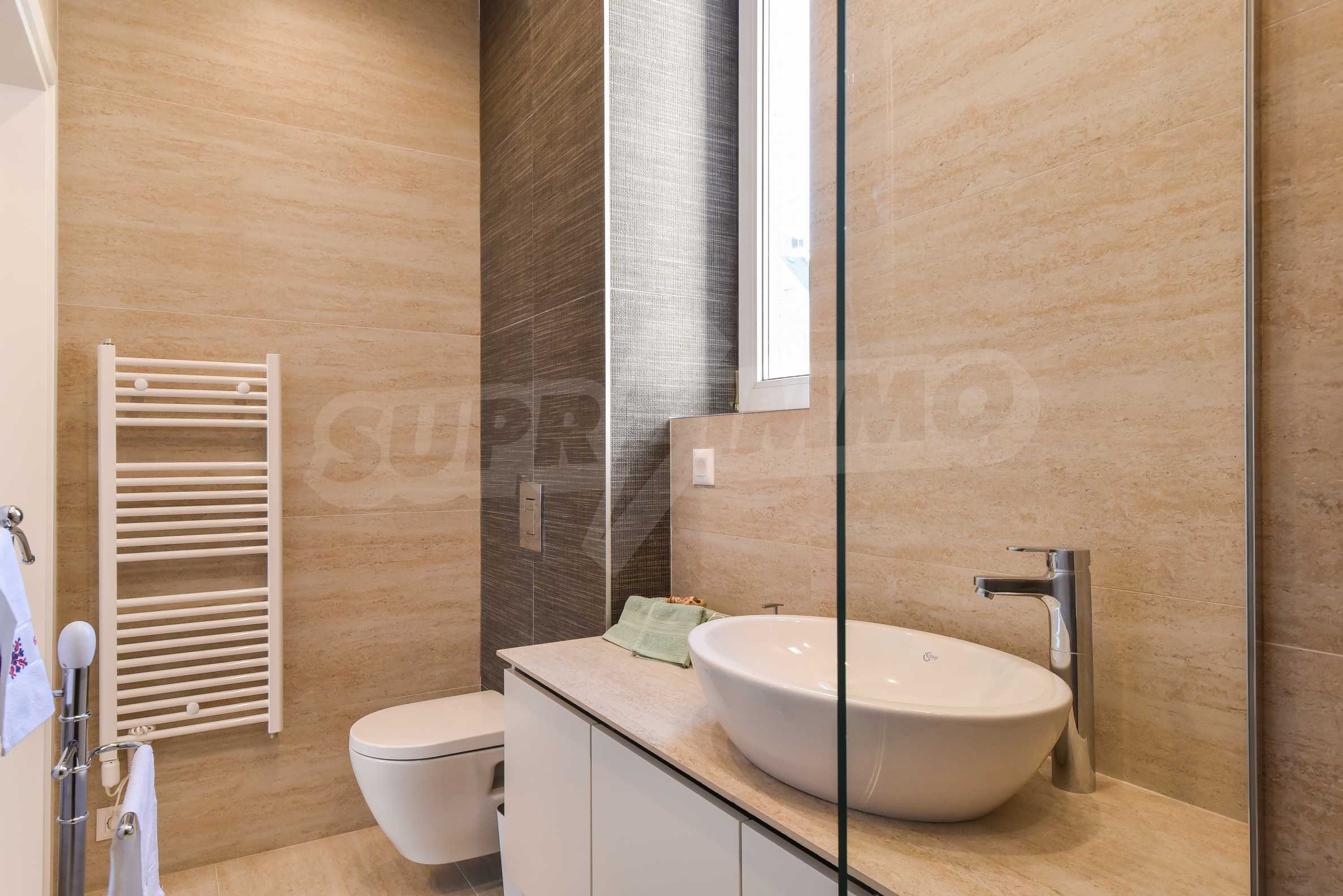 Modern three bedroom apartment with working business in the center of Sofia 24