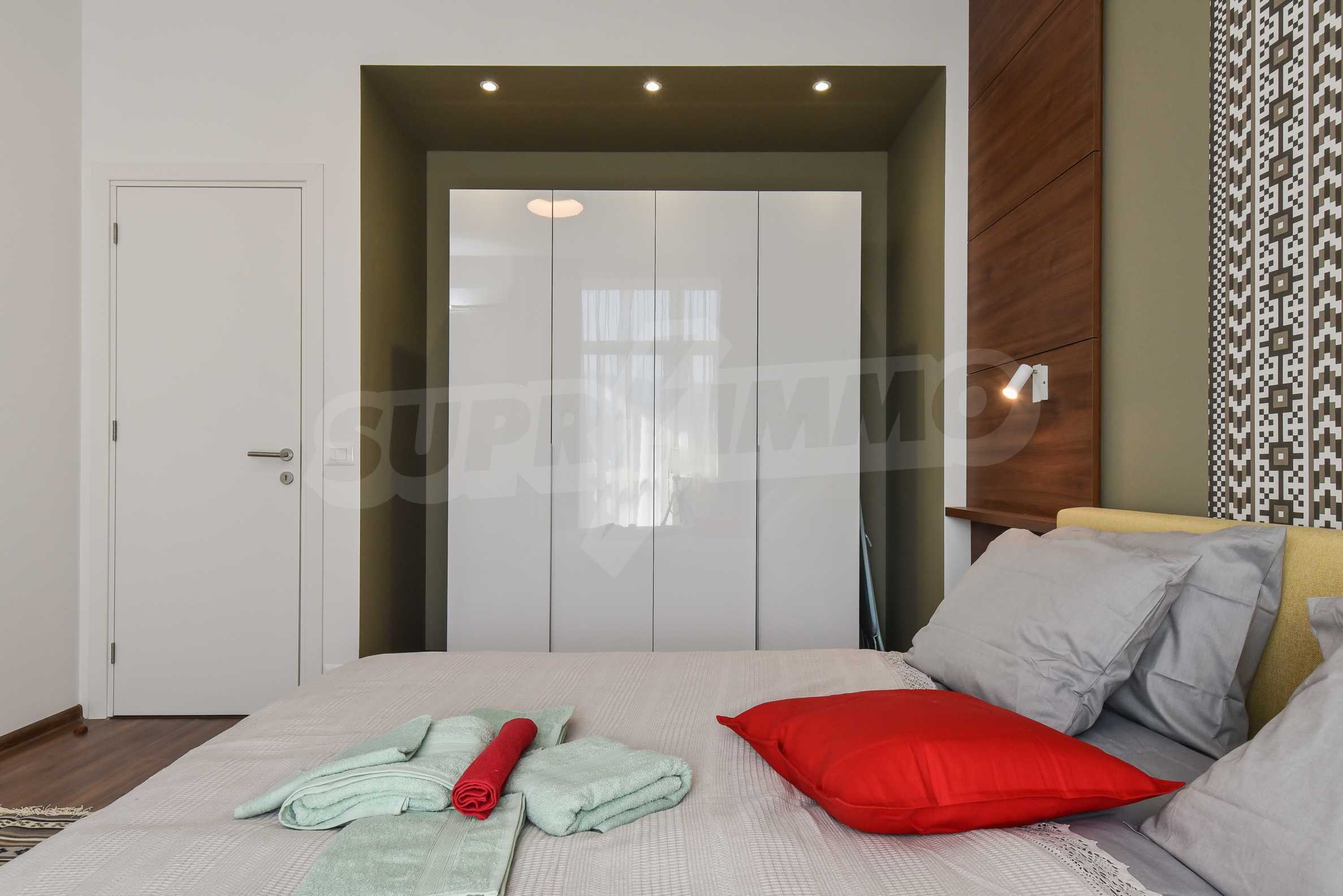 Designer two bedroom apartment in top center with working business 15