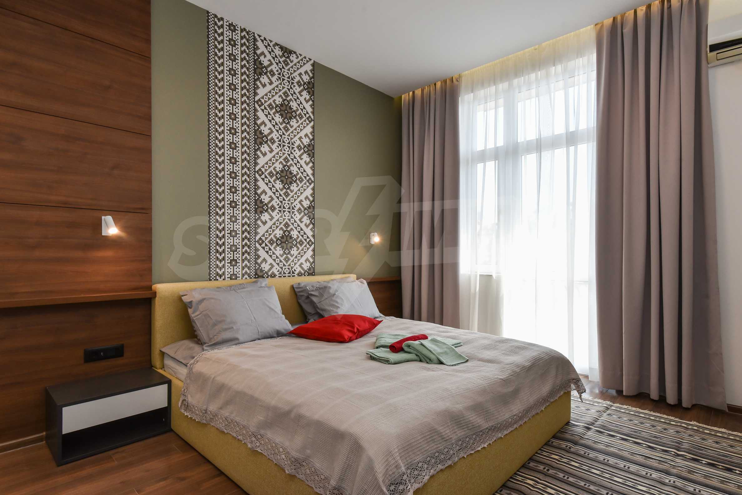 Designer two bedroom apartment in top center with working business 16