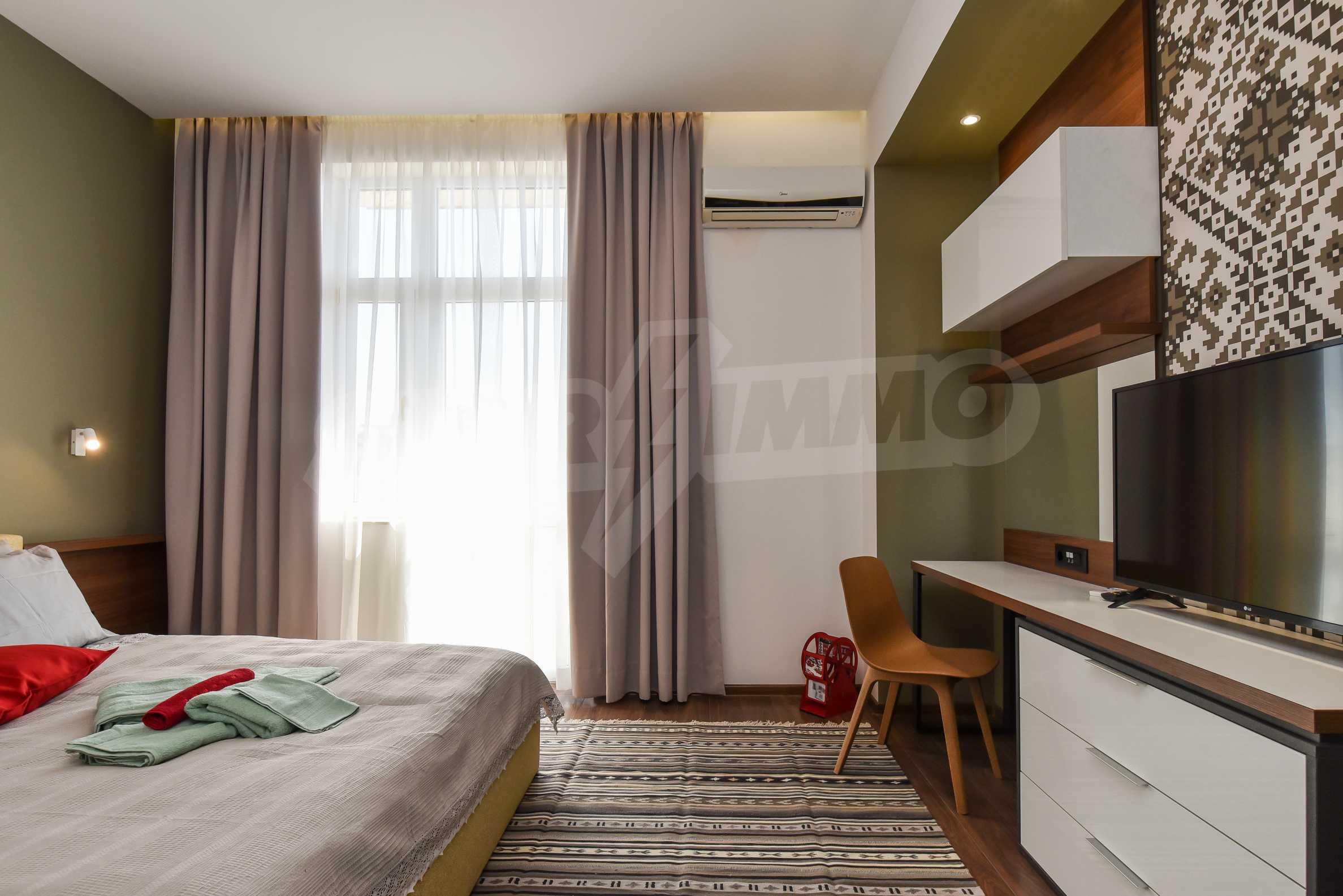 Designer two bedroom apartment in top center with working business 17