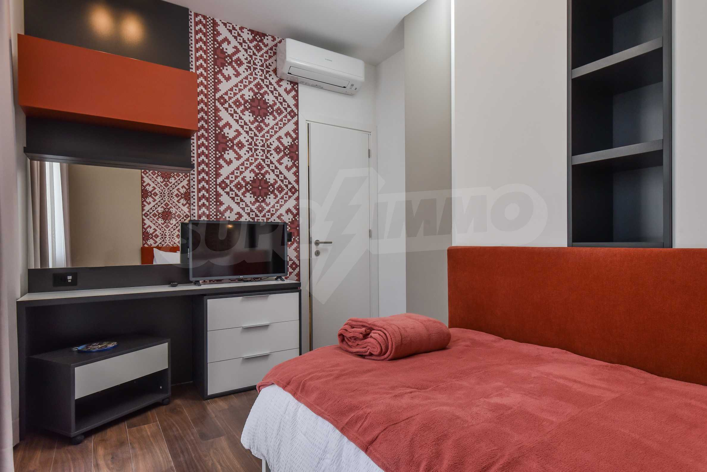Designer two bedroom apartment in top center with working business 21