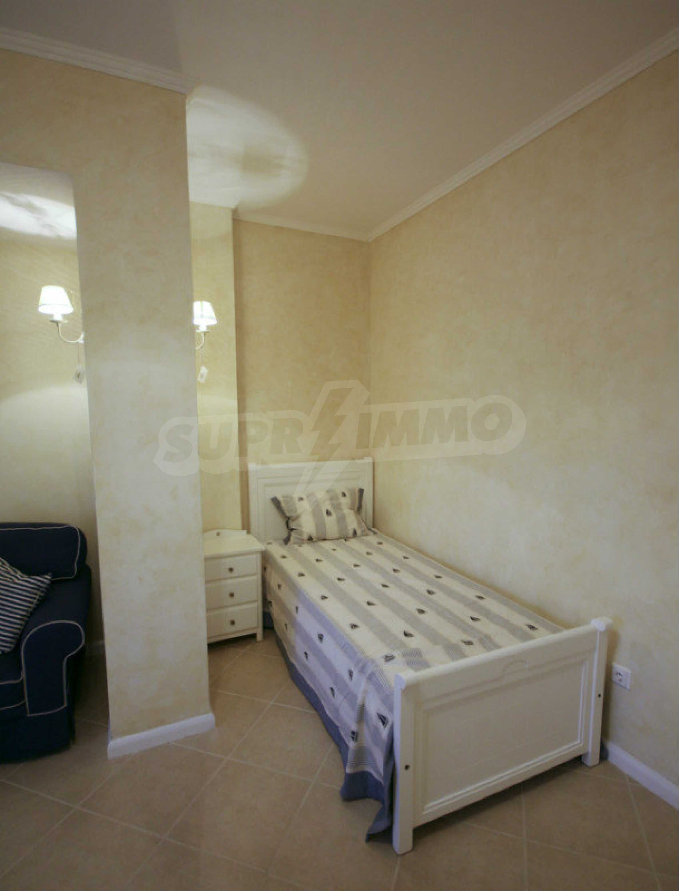 Two bedroom apartment with stylish furniture in a first line complex 10