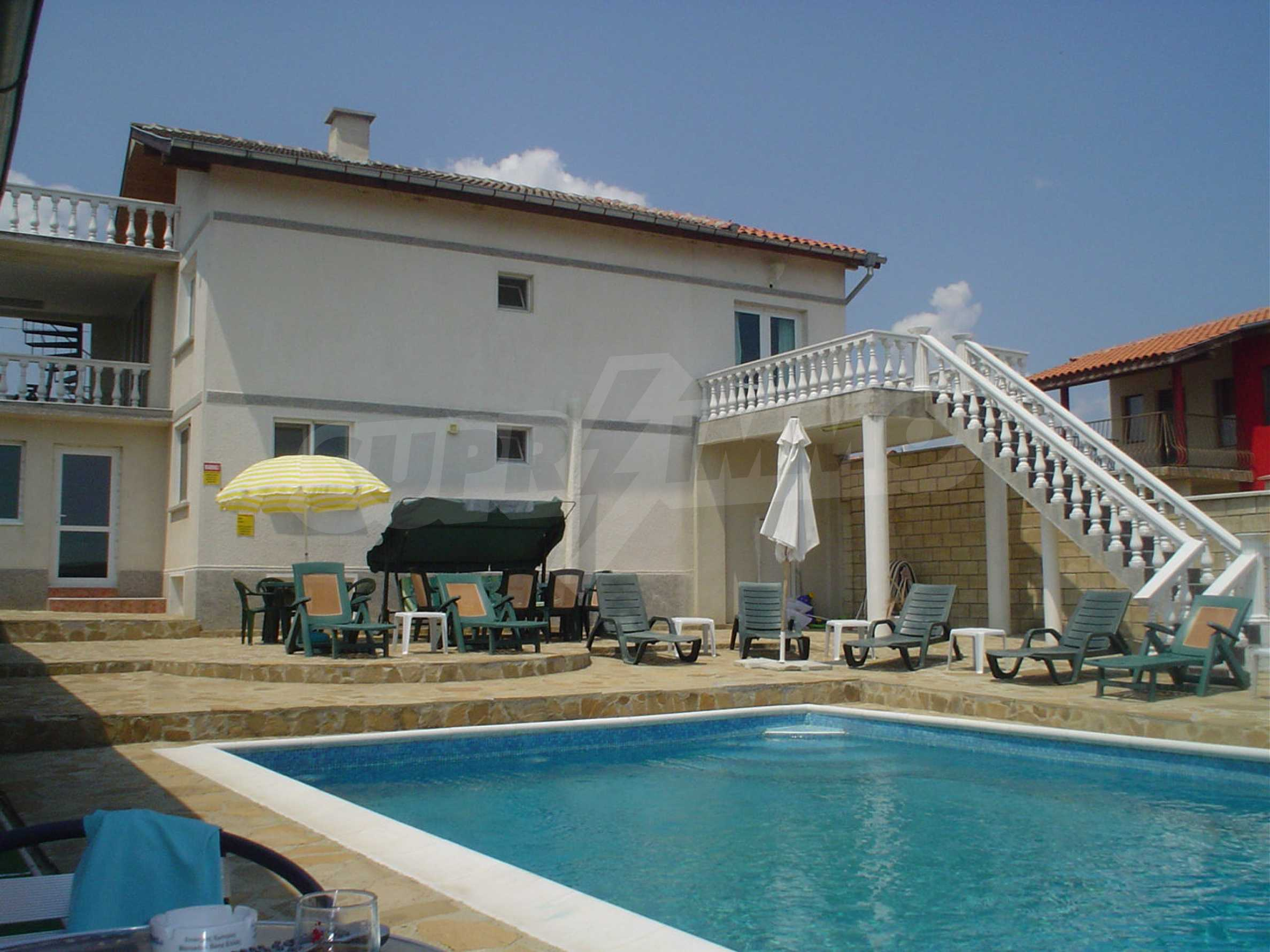 Nice guest house with pool and bar