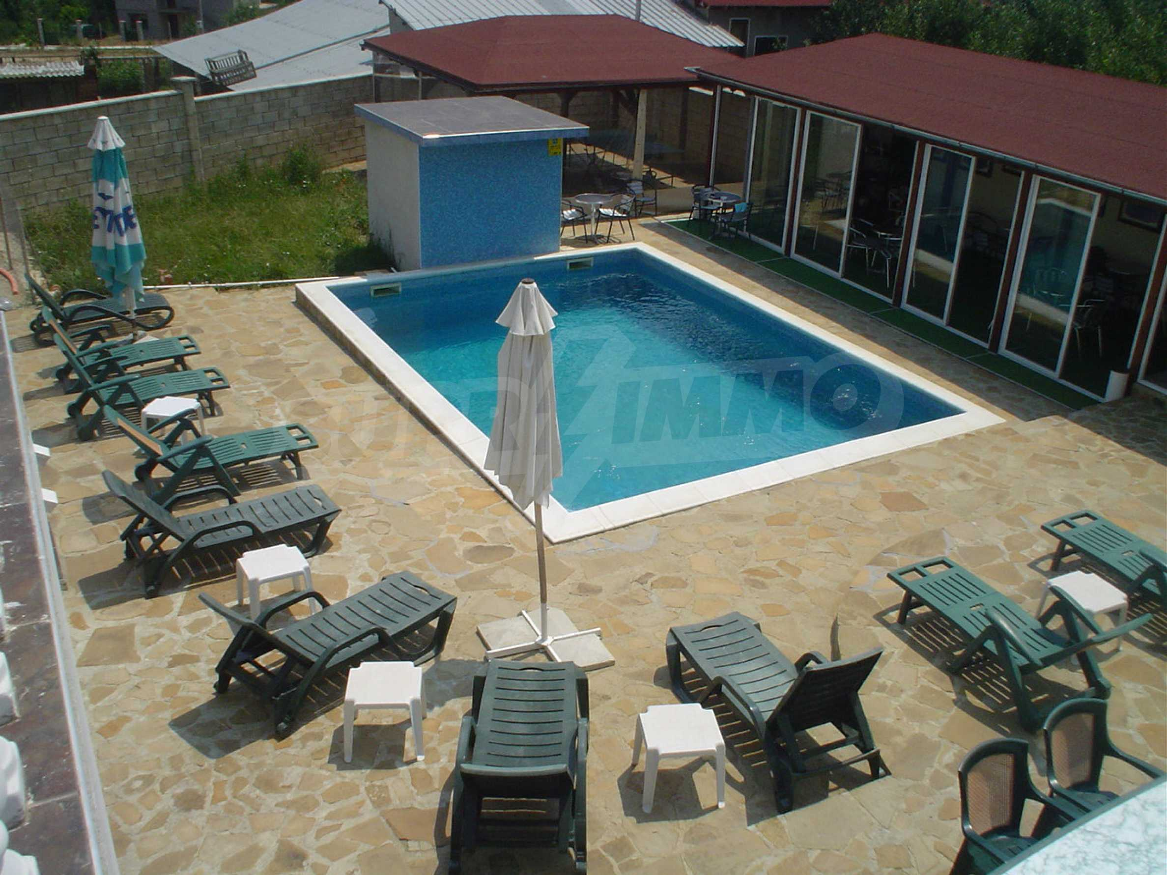 Nice guest house with pool and bar 4
