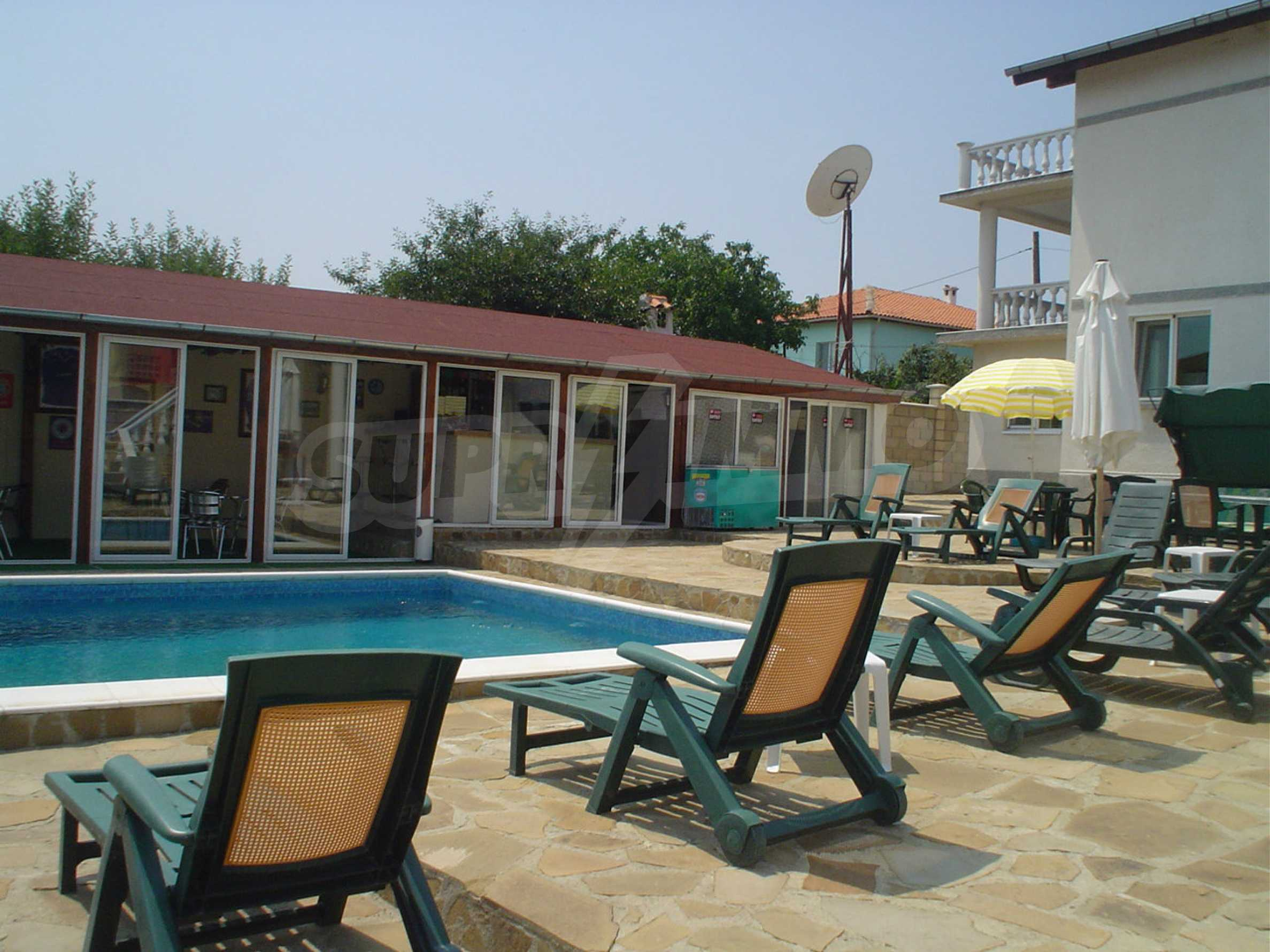 Nice guest house with pool and bar 6