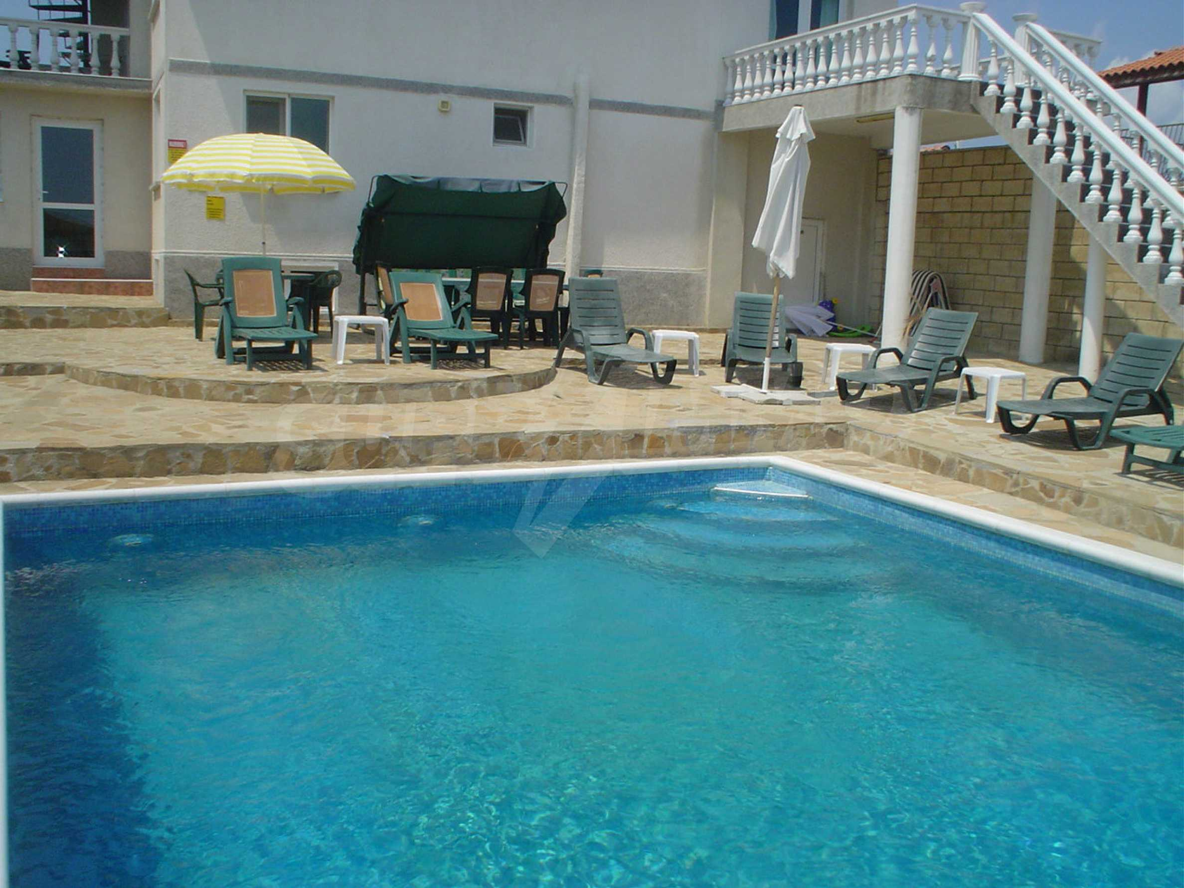 Nice guest house with pool and bar 7