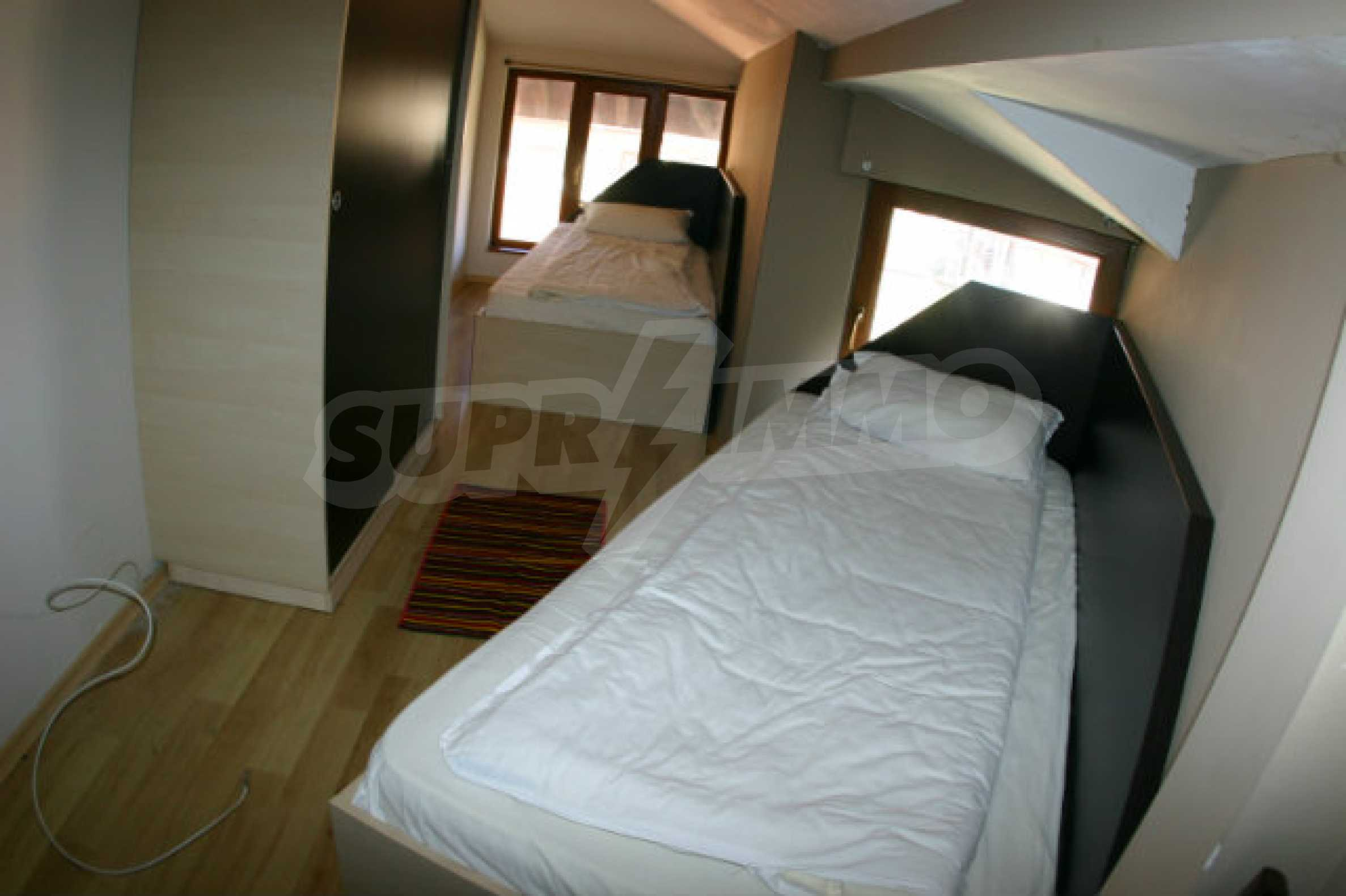 Four-bedroom apartment in Top Lodge complex 15