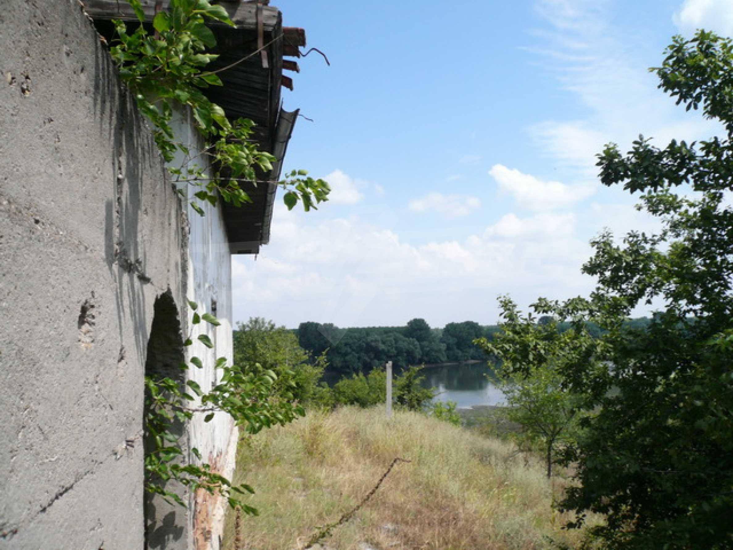 Haus am Ufer der Donau 4