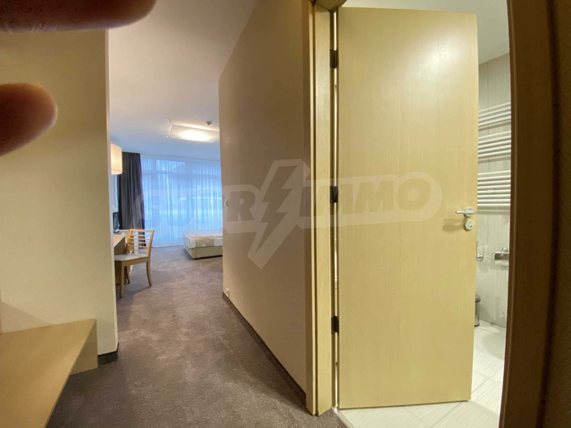 Stylishly furnished studio with southern exposure in Lucky Bansko complex 8