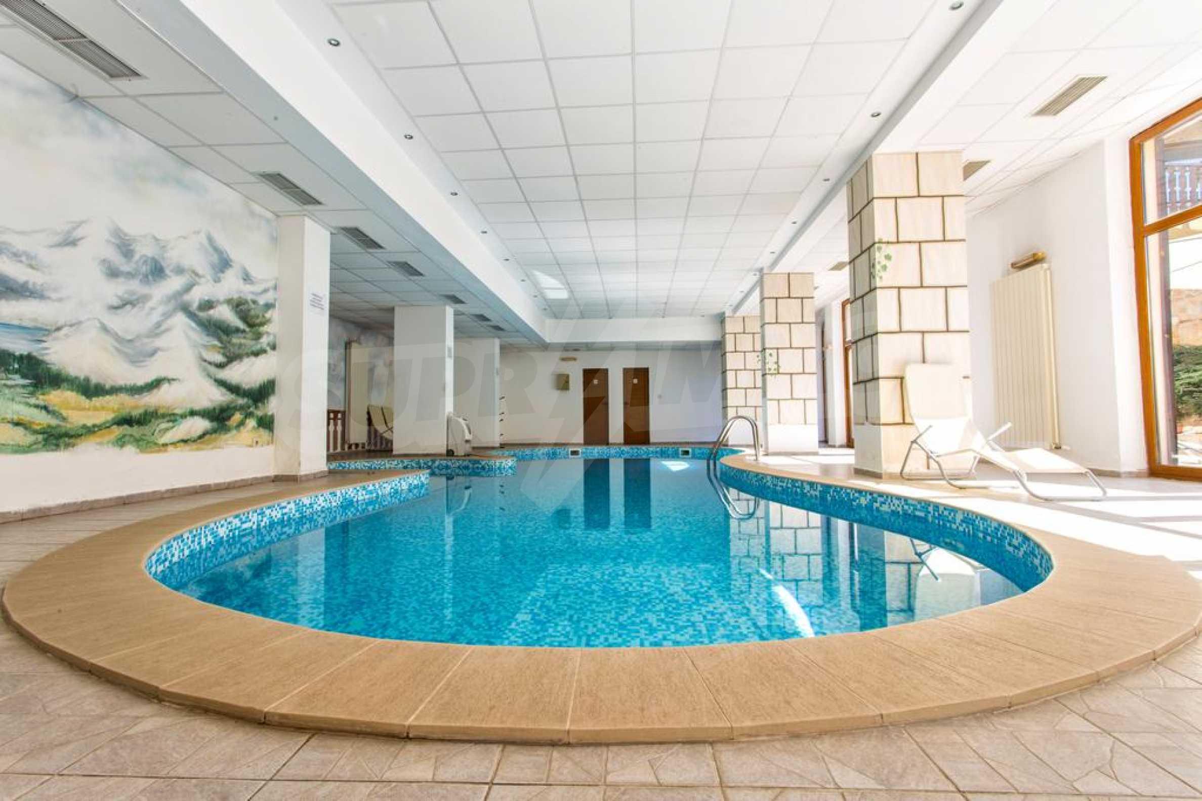 Уютен двустаен апартамент, разположен в комплекс Топ Лодж, само на метри от ски лифта в Банско 7