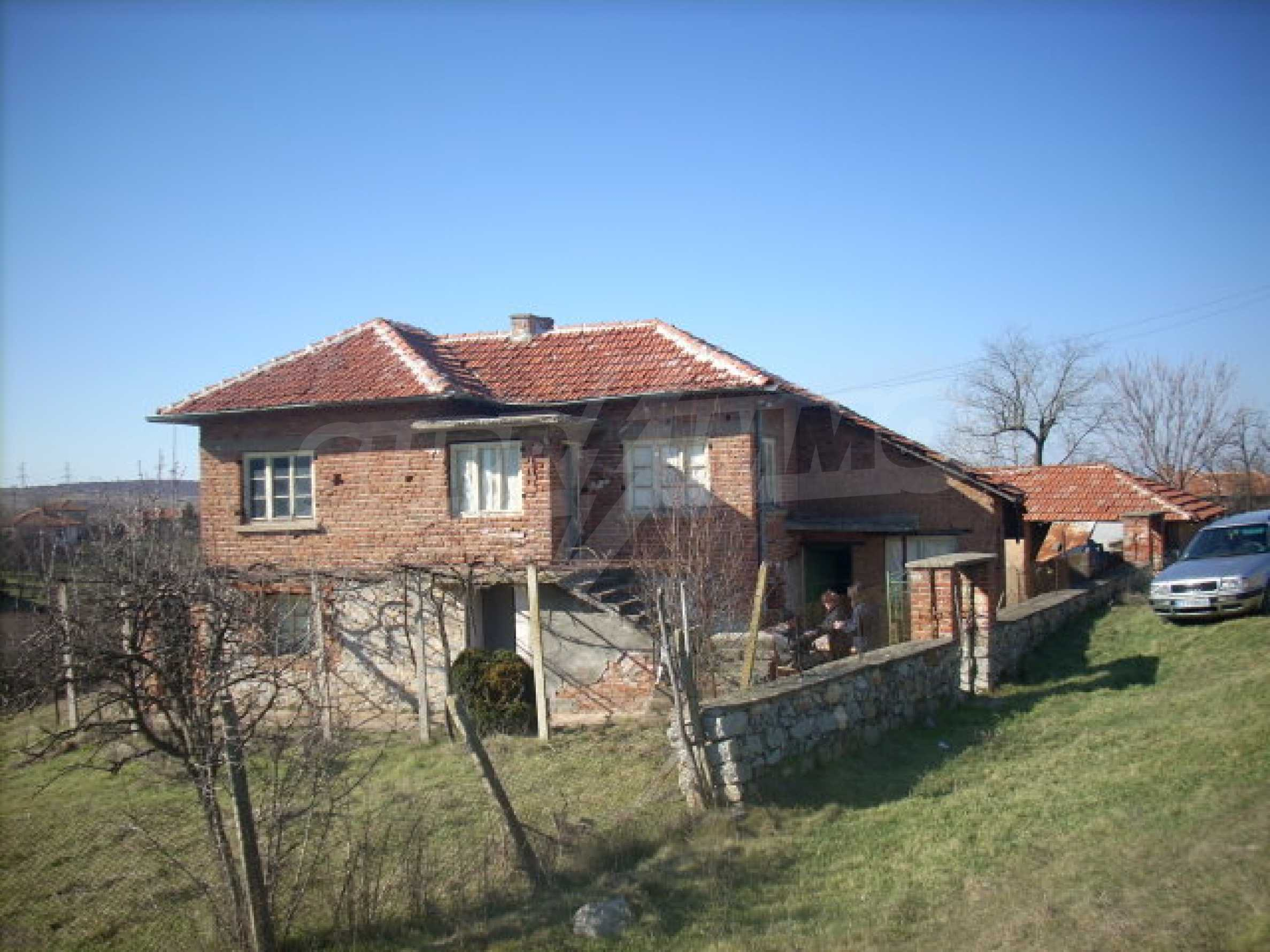 Solid, brick-built house with huge garden