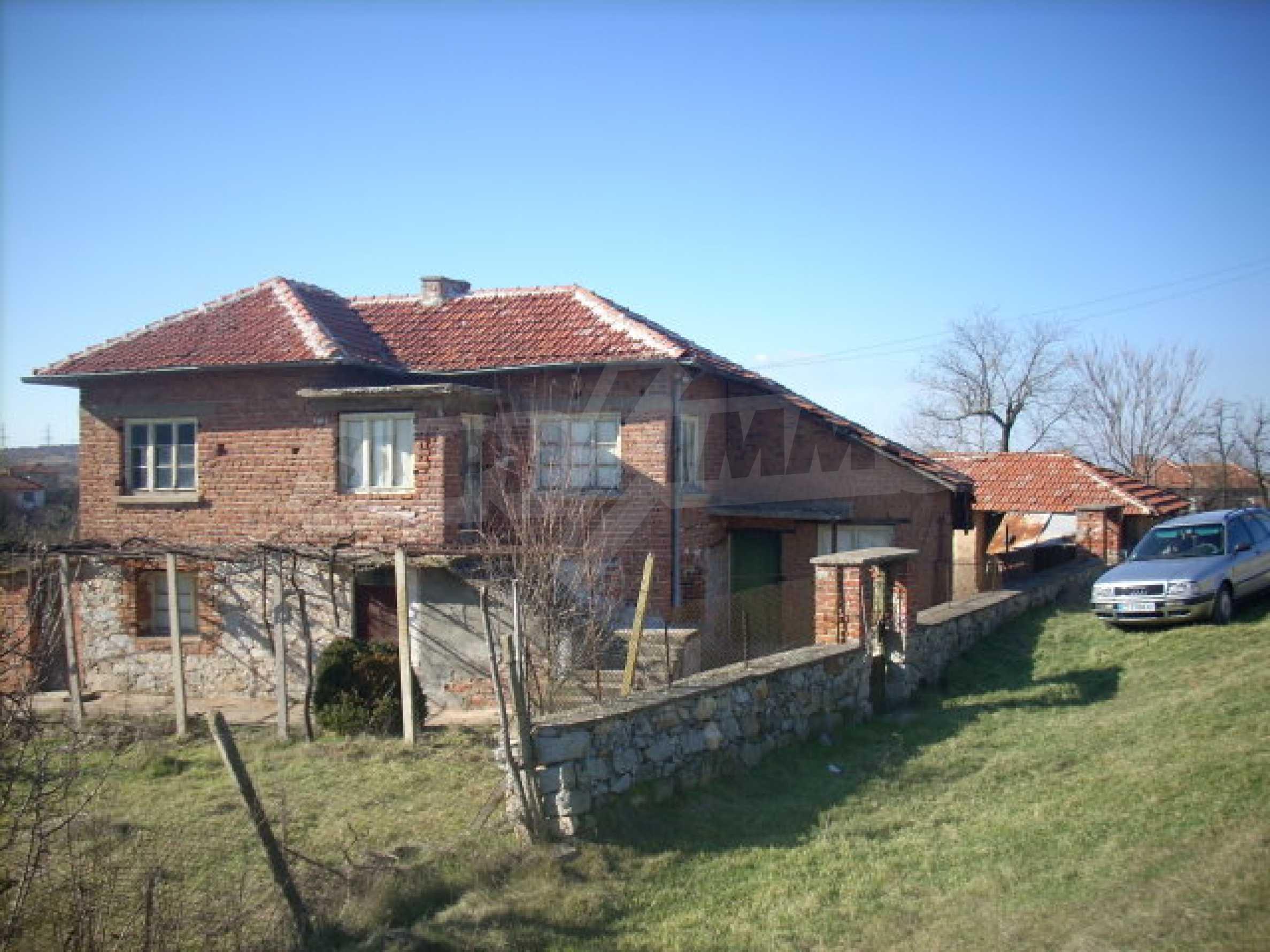 Solid, brick-built house with huge garden 1