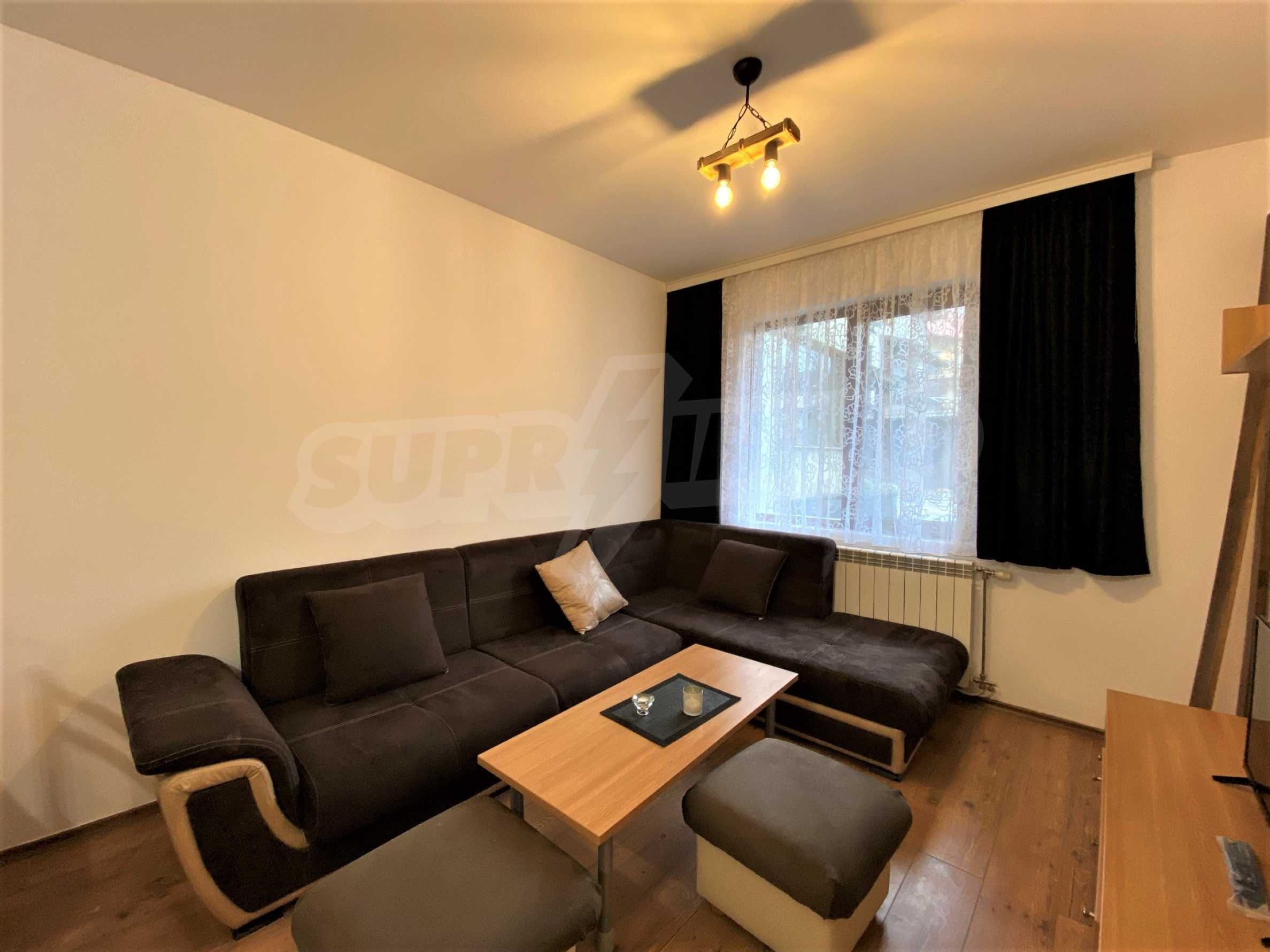 Two-bedroom apartment in a well-maintained building in Bansko 1