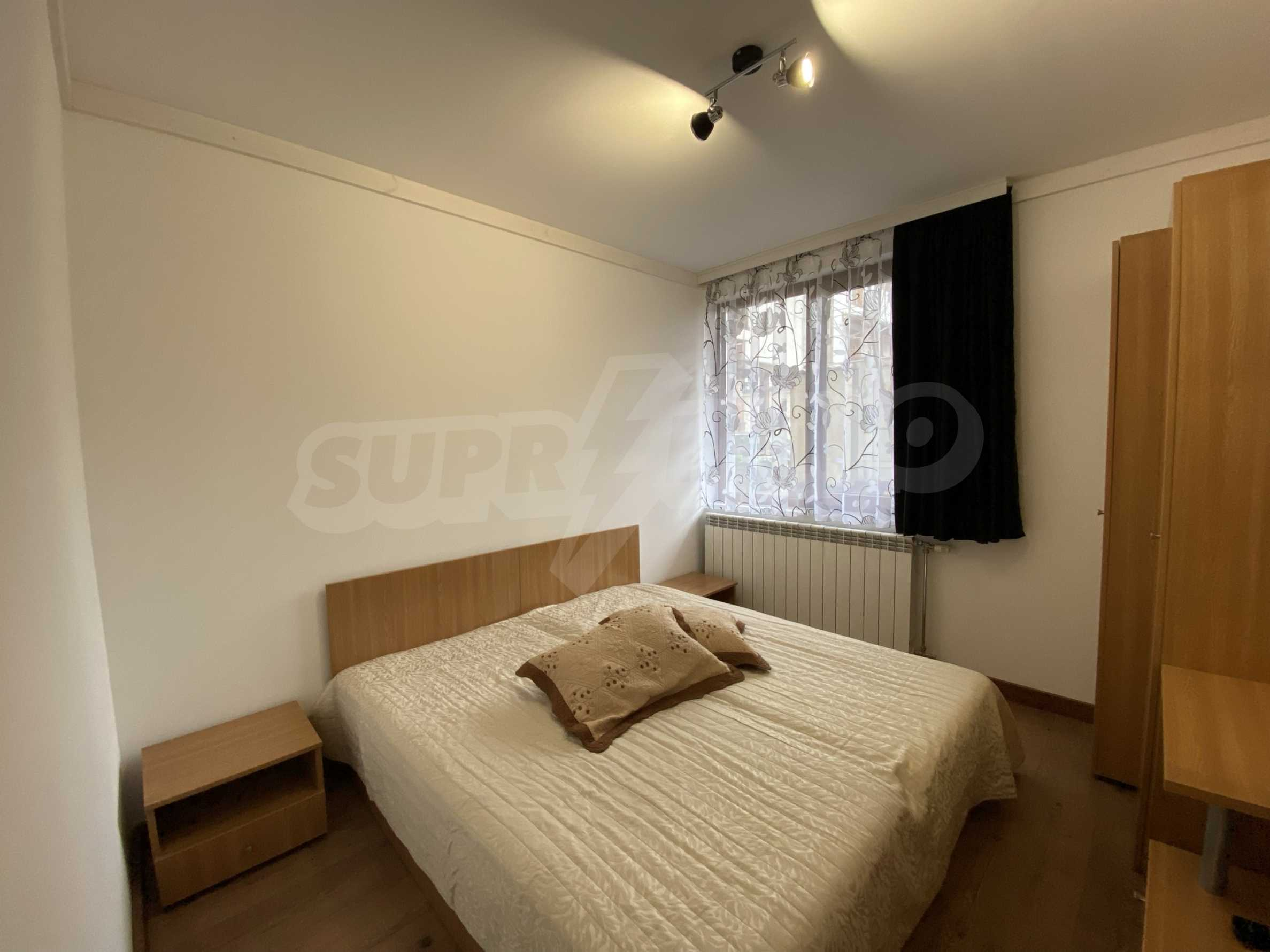 Two-bedroom apartment in a well-maintained building in Bansko 6