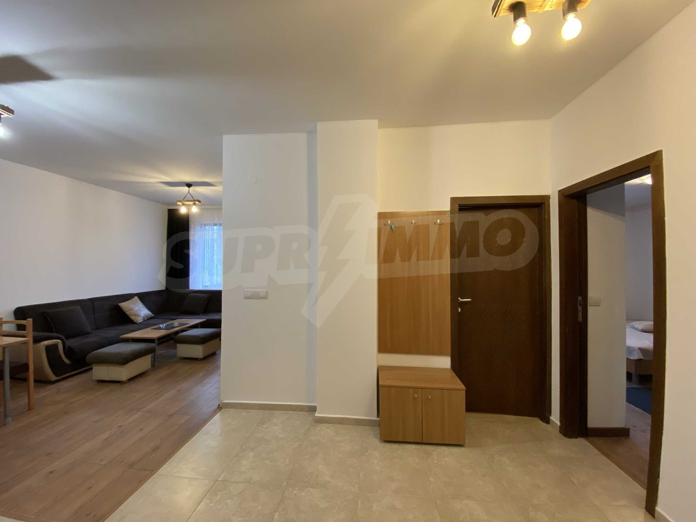 Two-bedroom apartment in a well-maintained building in Bansko 8
