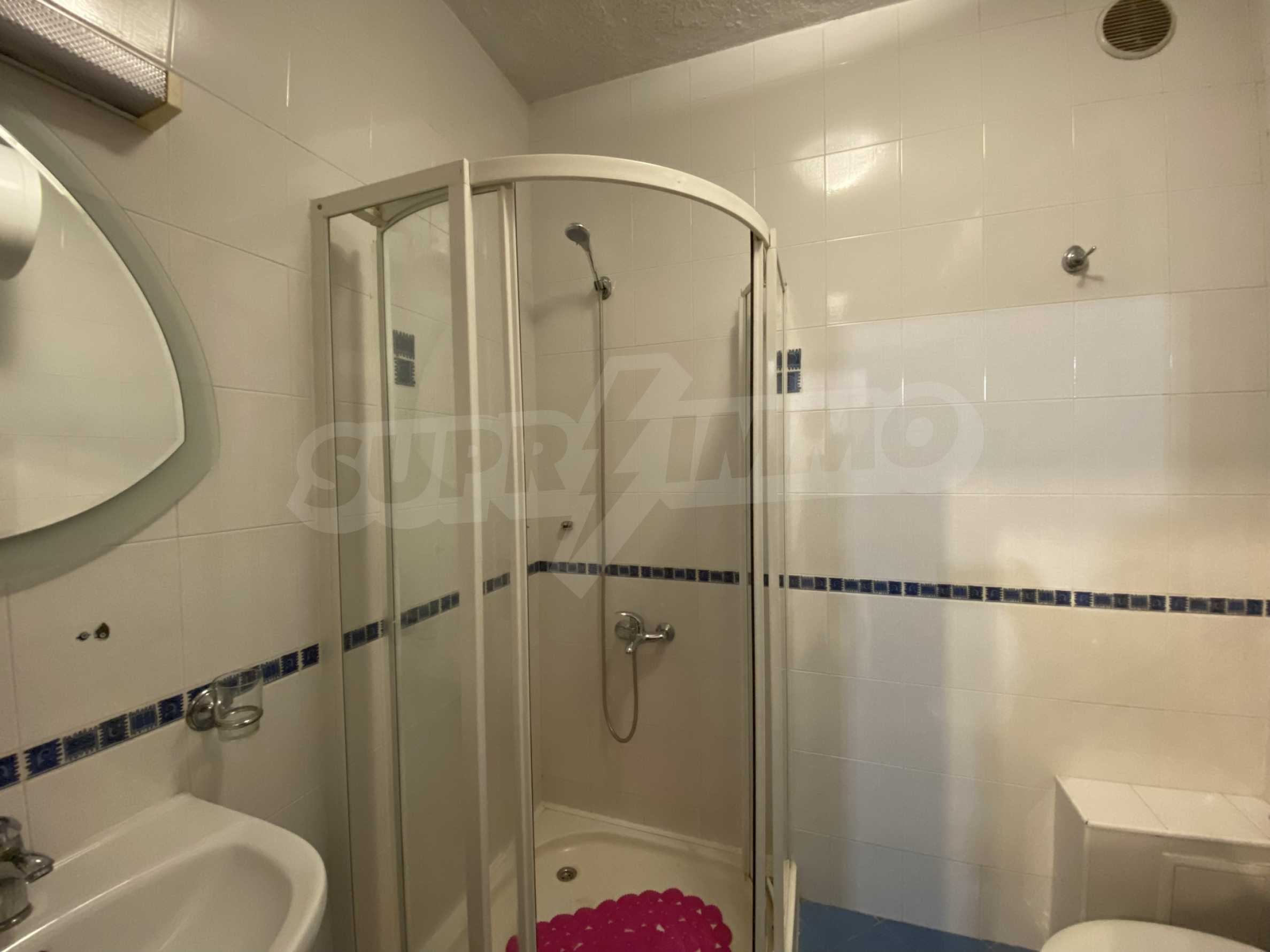 Two-bedroom apartment in a well-maintained building in Bansko 9