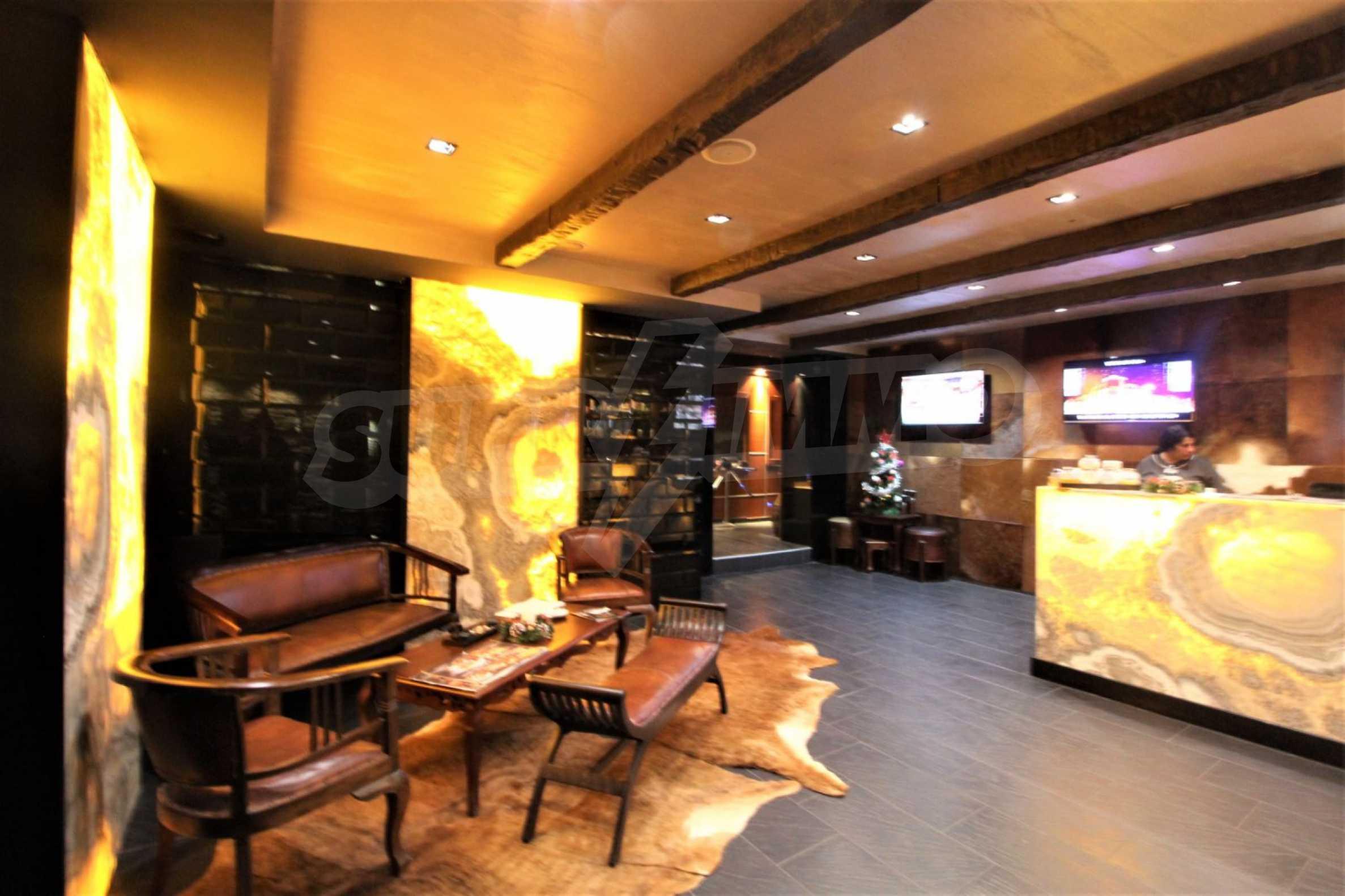 Обзаведен тристаен апартамент в луксозен комплекс Гранд Хотел Банско 24
