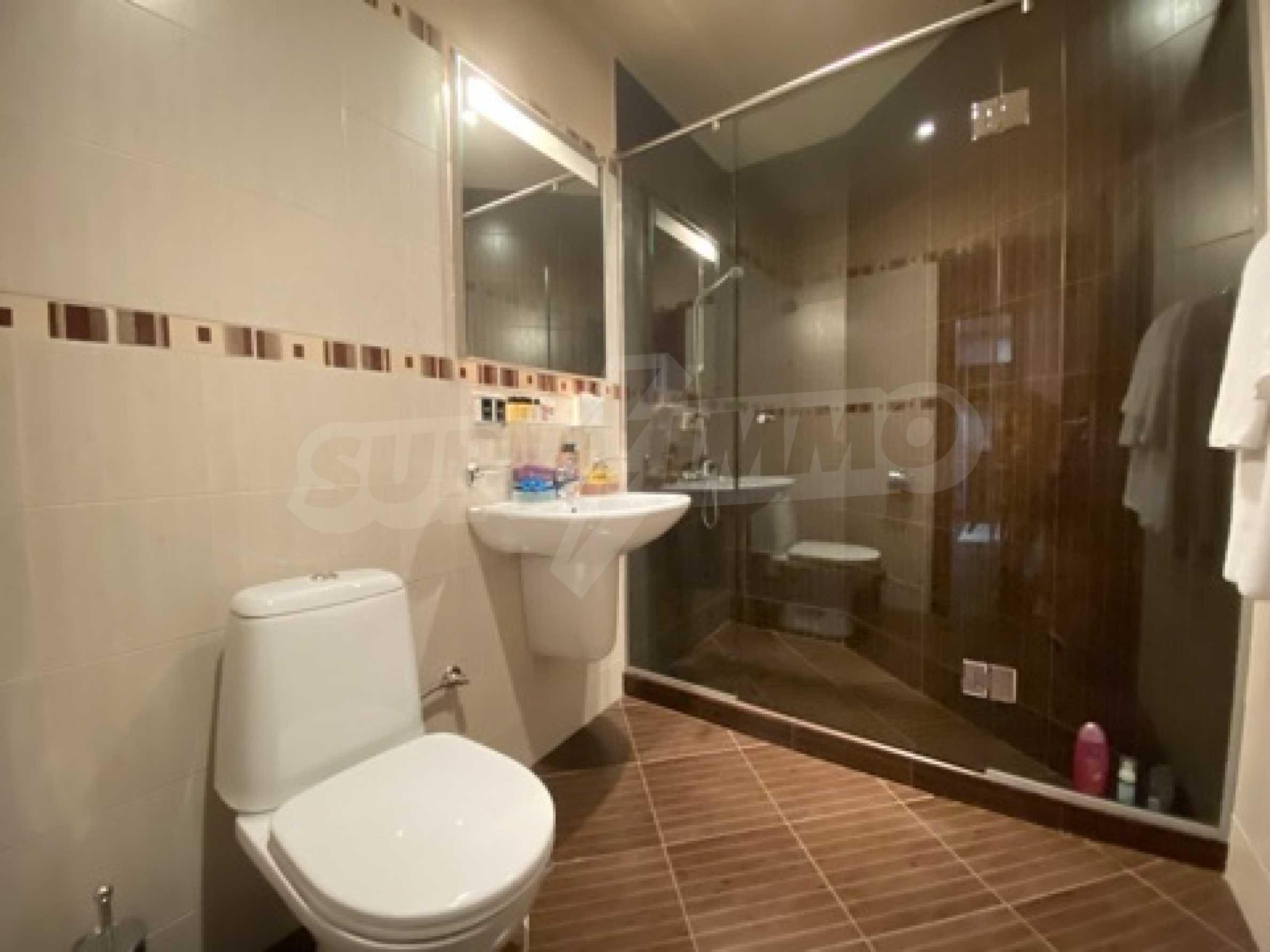 Обзаведен тристаен апартамент в луксозен комплекс Гранд Хотел Банско 8