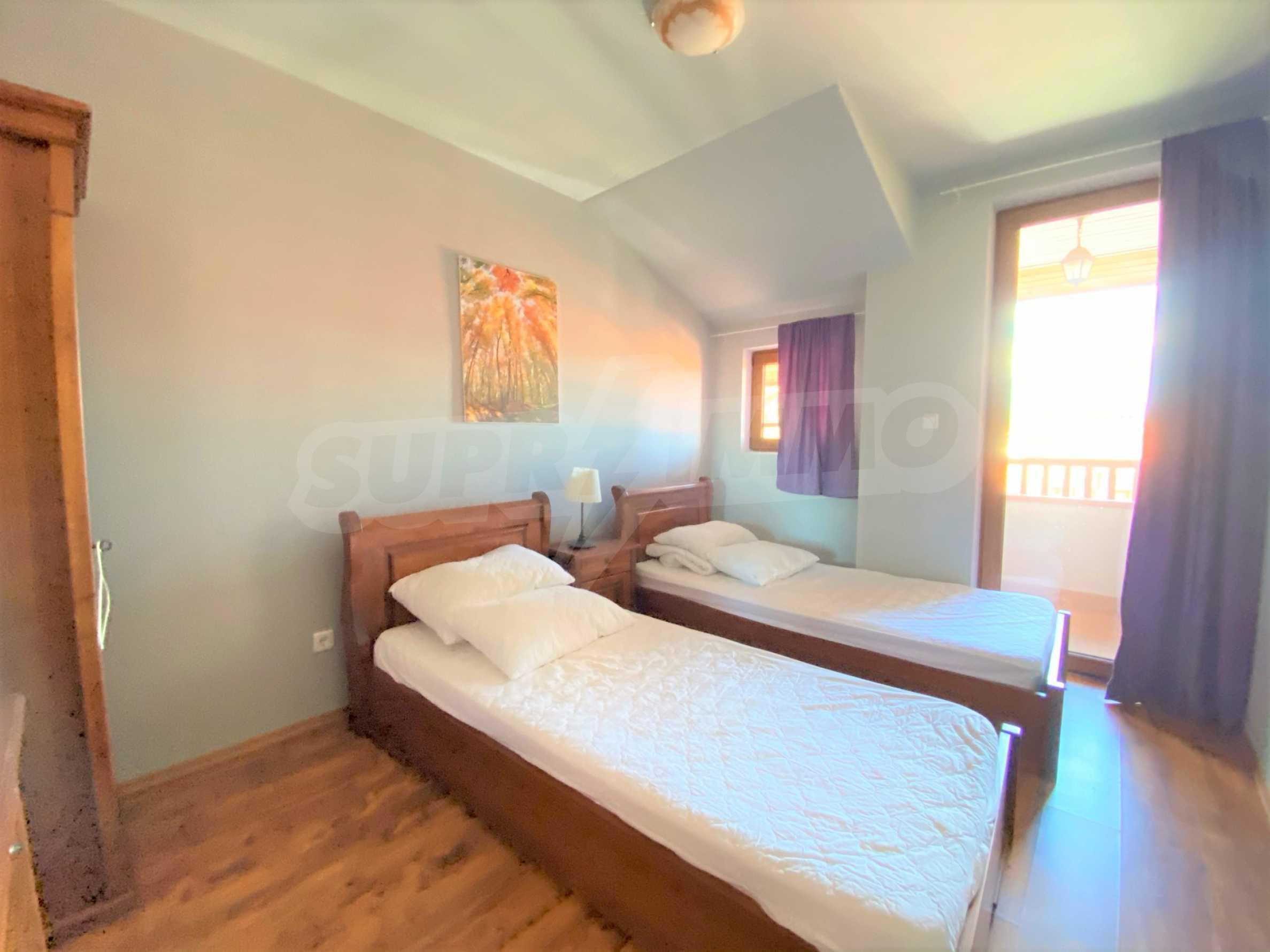 Апартамент с три спални с уникална панорамна гледка към Пирин планина в луксозен комплекс 11